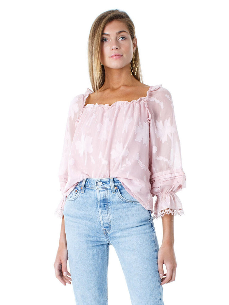 Women wearing a top rental from FashionPass called Adienna Ruffled Metallic Lurex Blouse
