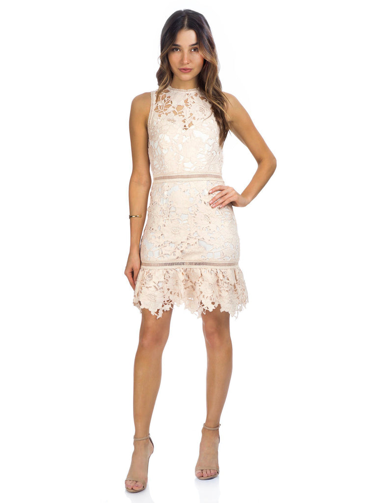Woman wearing a dress rental from Saylor called Frills Mini Dress