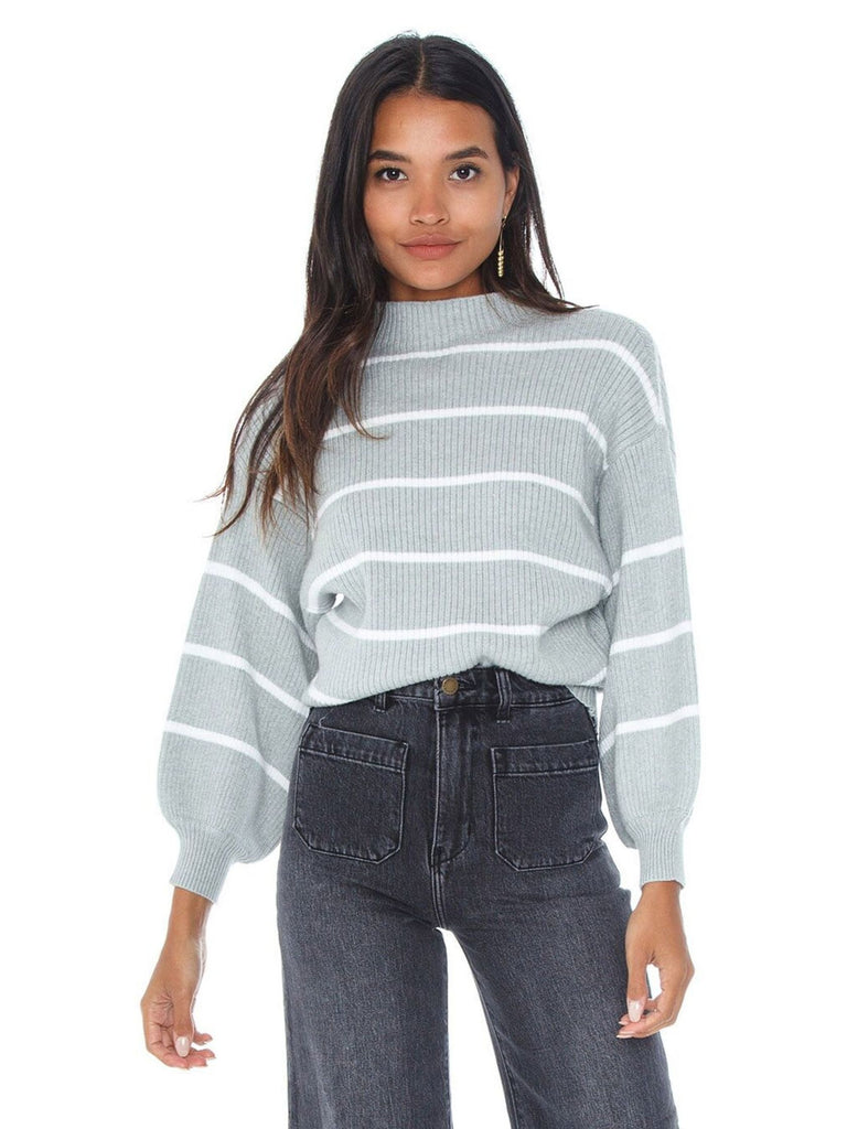 Woman wearing a sweater rental from Line & Dot called Chiara Ruffled Top
