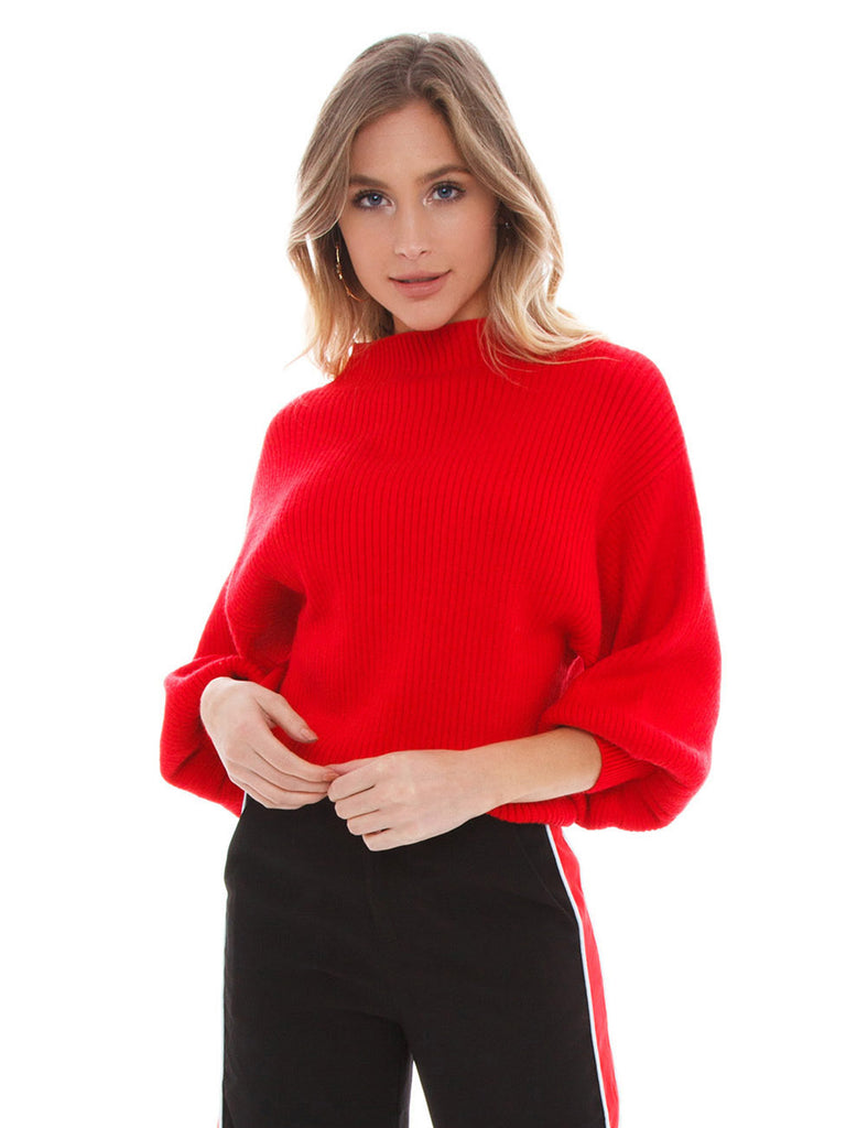 Girl wearing a top rental from Line & Dot called Jasper Fringe Sweater