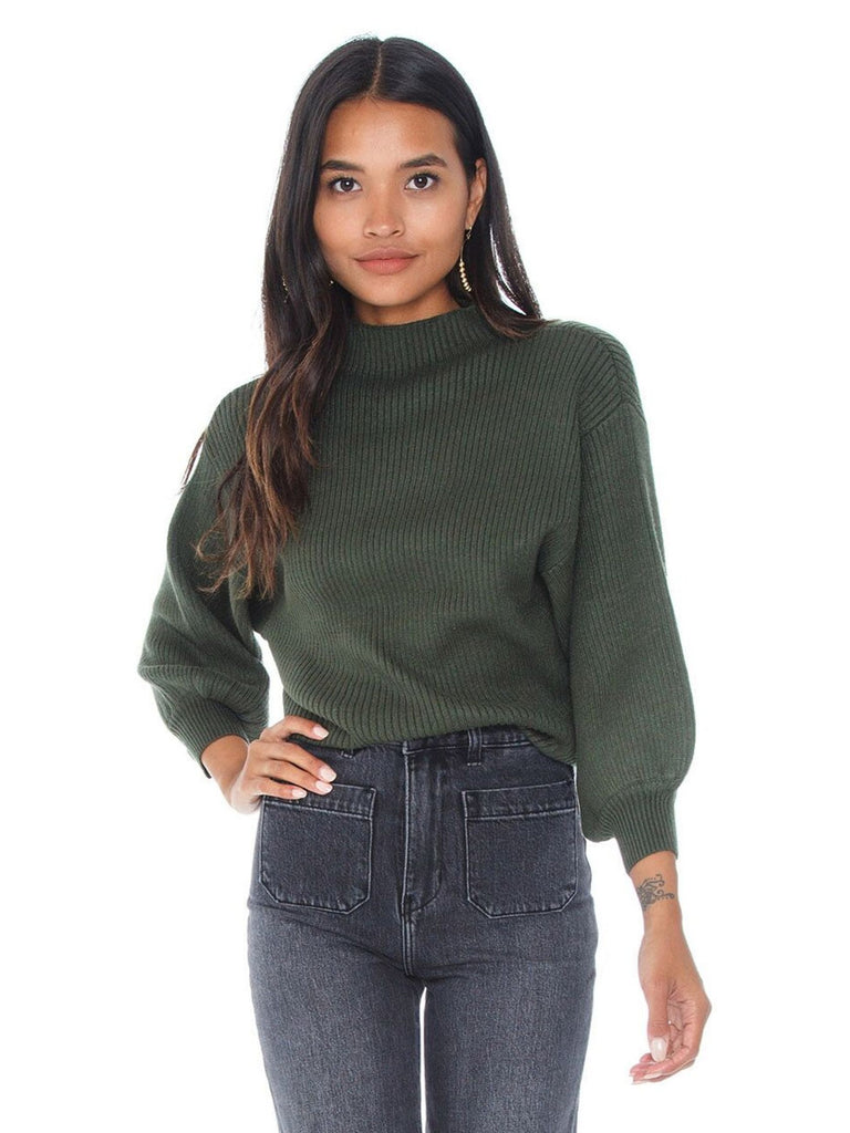 Women wearing a sweater rental from Line & Dot called Say It To Me Bodysuit