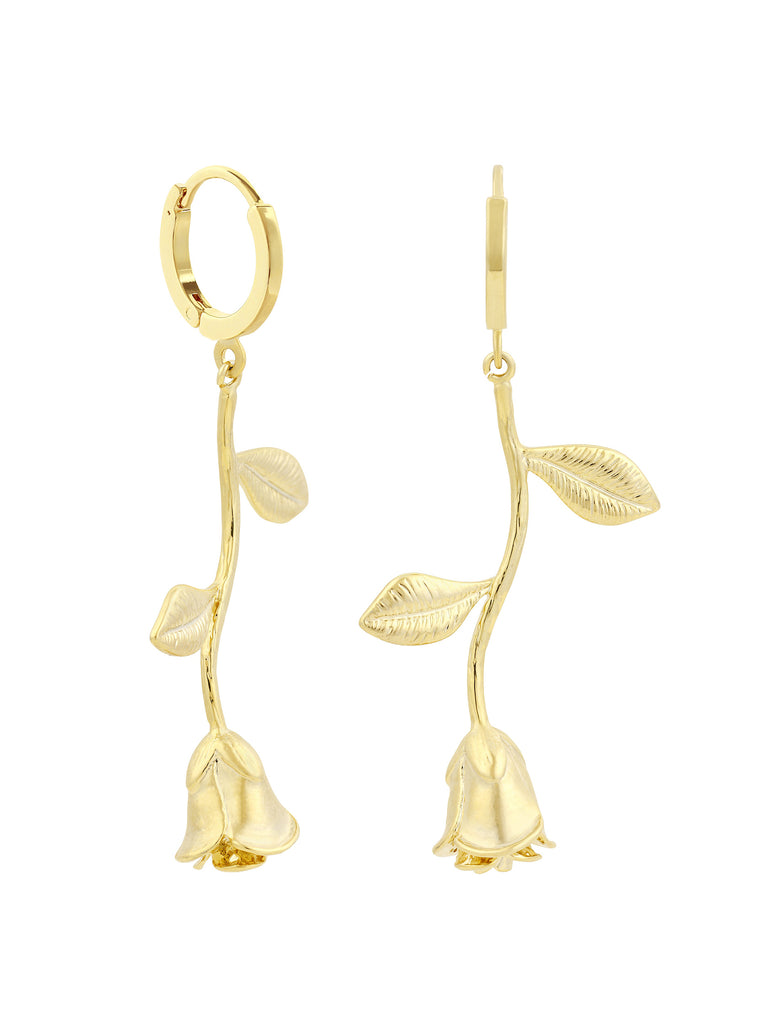 Women wearing a earrings rental from Five and Two called Ellie Coral Tassel Earrings