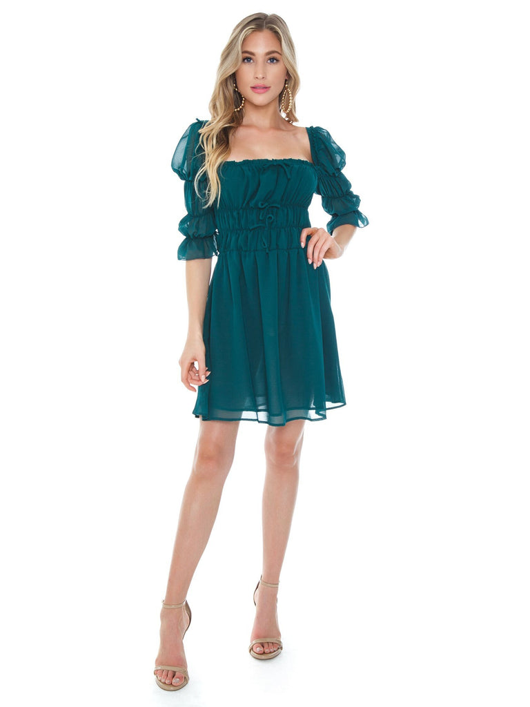 Women outfit in a dress rental from Lani The Label called Ruched Side Dress