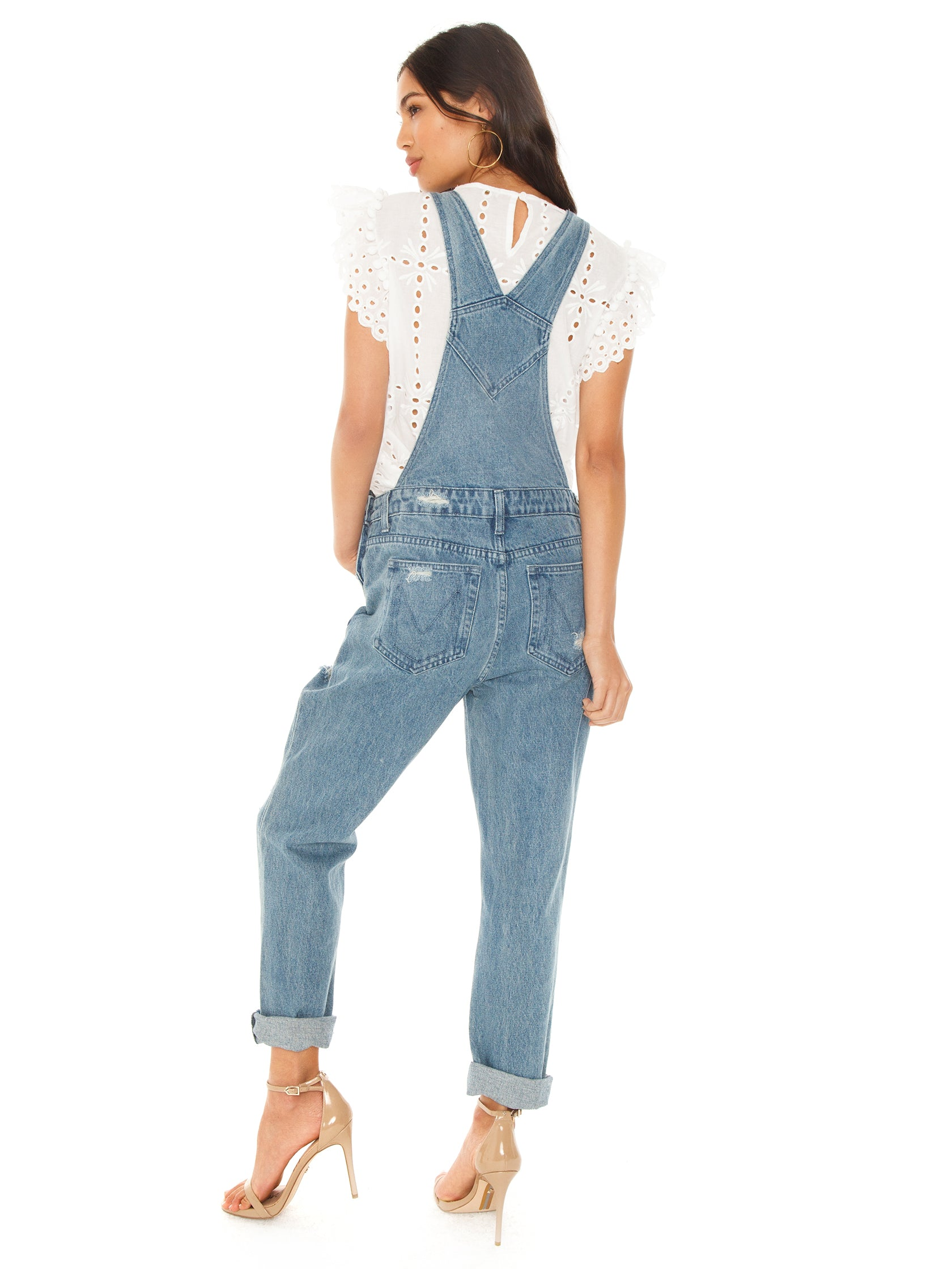 Girl wearing a overalls rental from Show Me Your Mumu called Alma Overalls