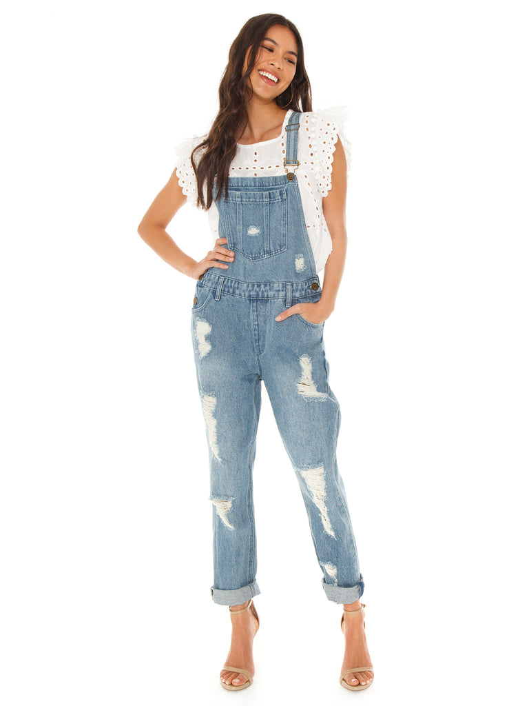 Woman wearing a overalls rental from Show Me Your Mumu called Sedona Skirt