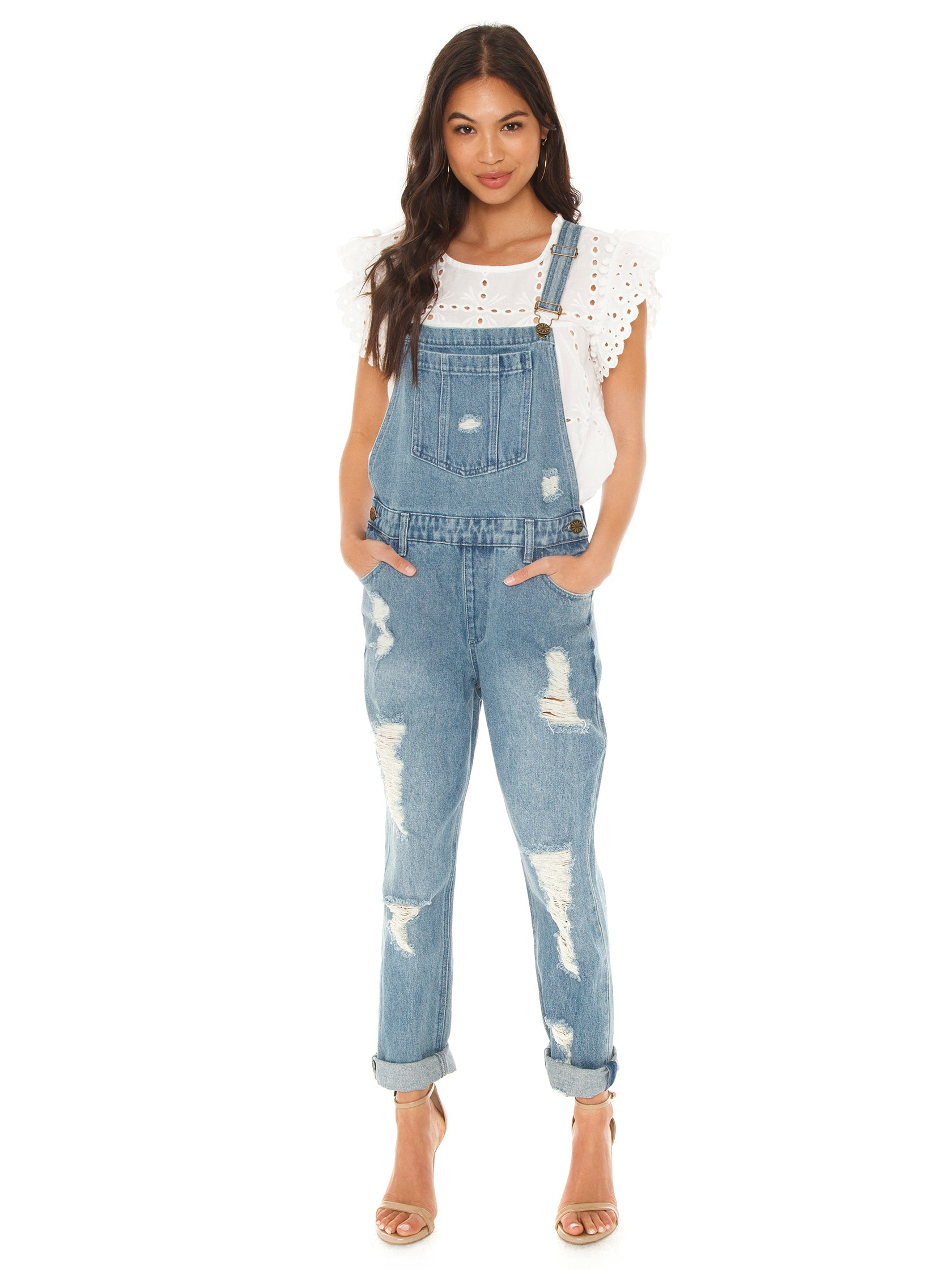 Women wearing a overalls rental from Show Me Your Mumu called Alma Overalls