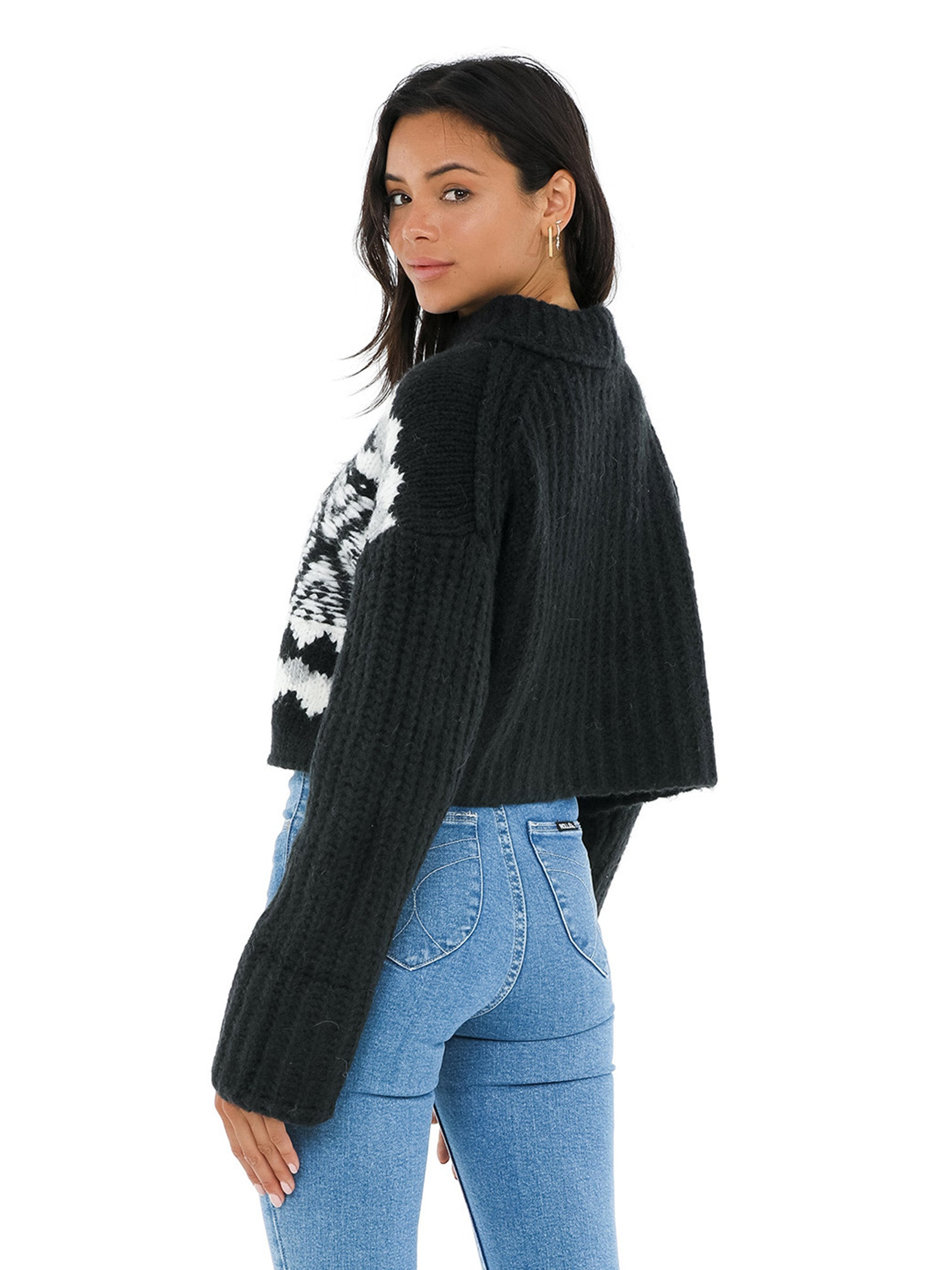 Girl wearing a sweater rental from Free People called Alpine Pullover