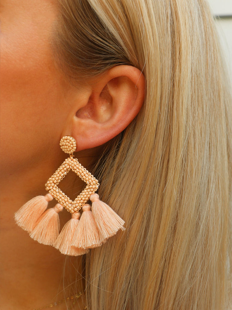 Women wearing a earrings rental from FashionPass called Amanda Tassel Earrings
