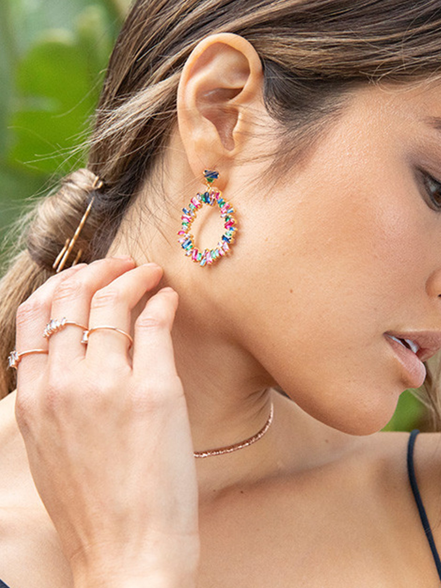 Girl wearing a earrings rental from Gorjana called Amara Cluster Drop Hoop