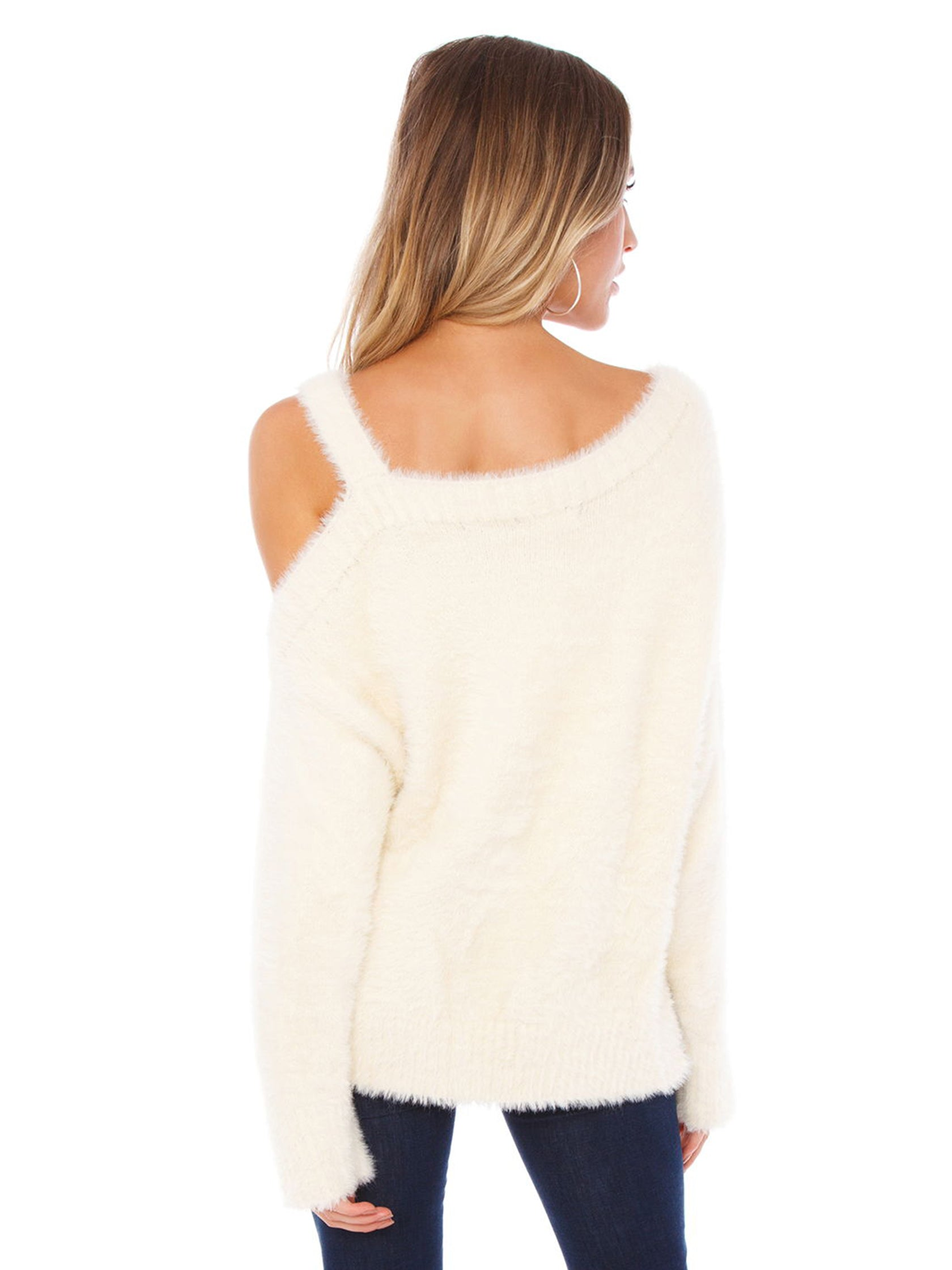 Women outfit in a sweater rental from FashionPass called Amy Cold Shoulder Sweater
