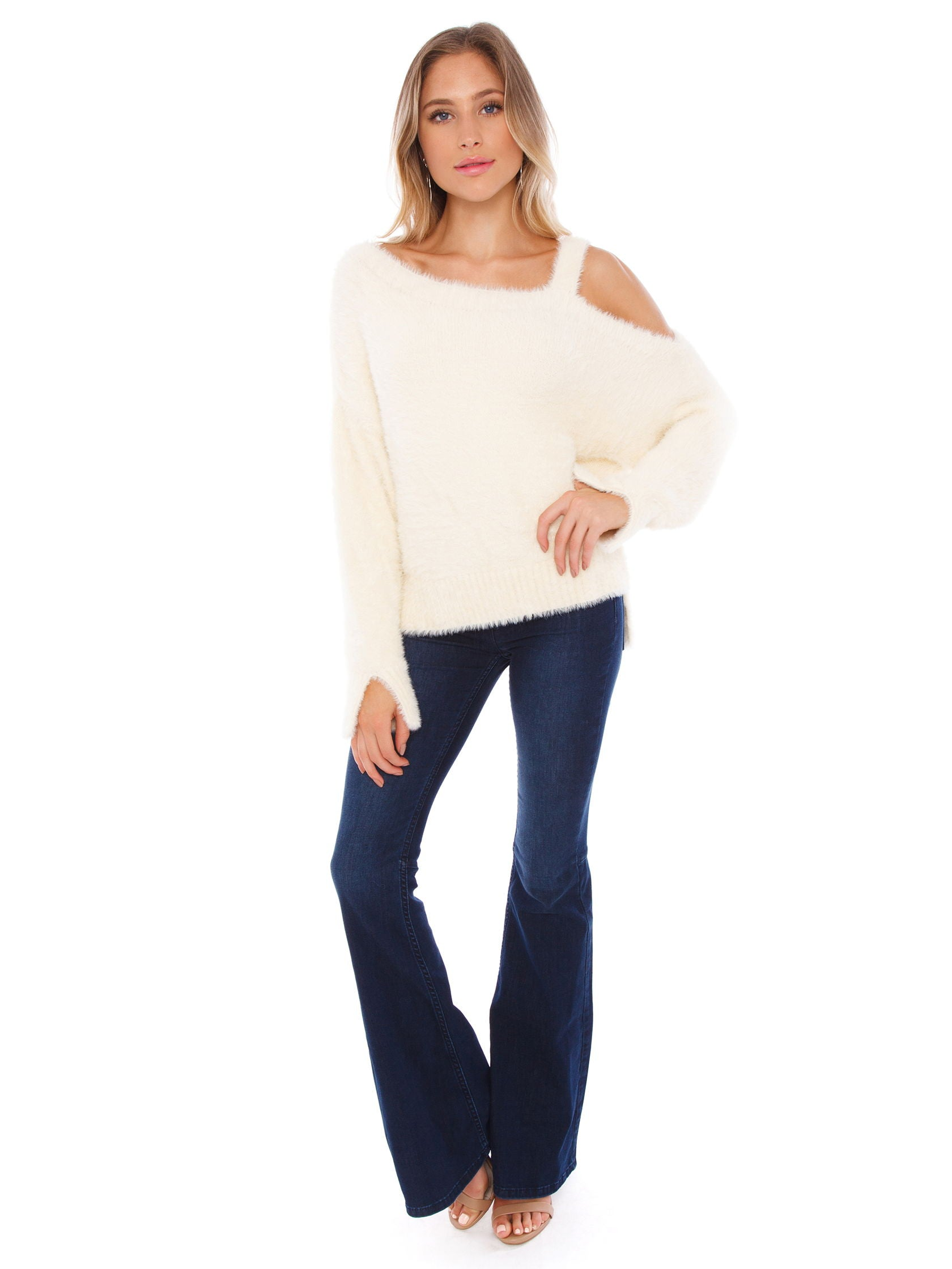 Girl wearing a sweater rental from FashionPass called Amy Cold Shoulder Sweater