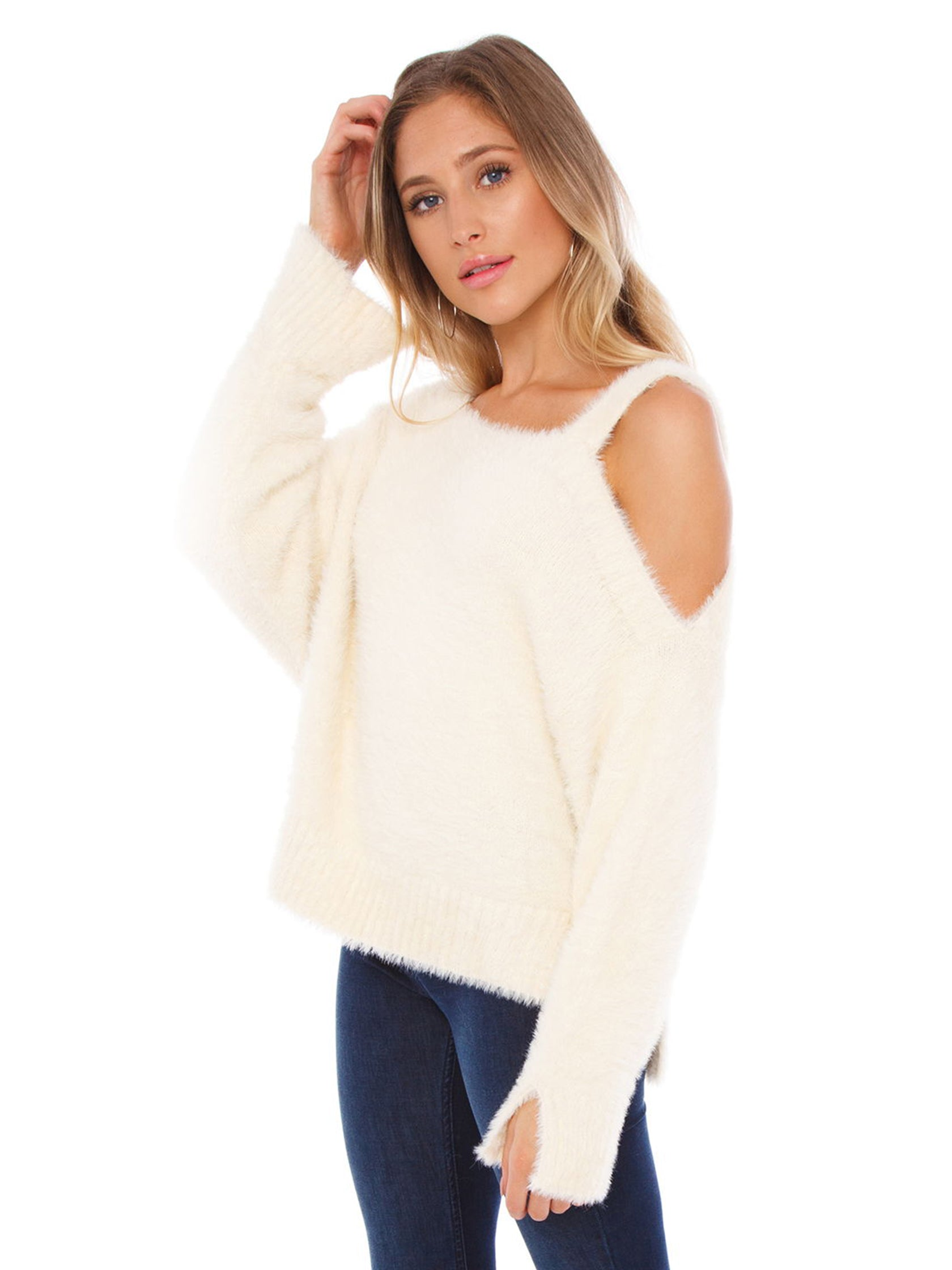 Women wearing a sweater rental from FashionPass called Amy Cold Shoulder Sweater