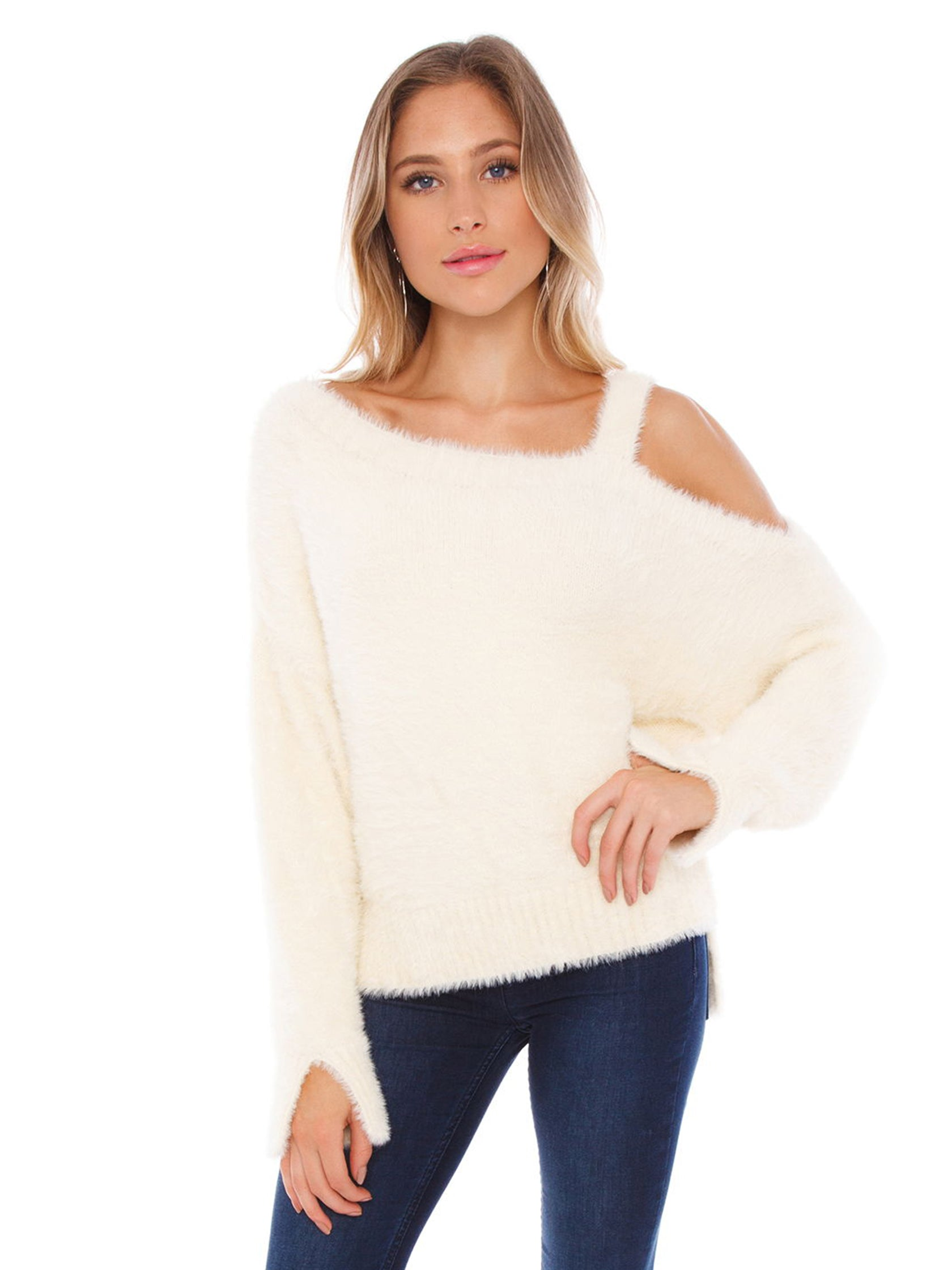 Woman wearing a sweater rental from FashionPass called Amy Cold Shoulder Sweater