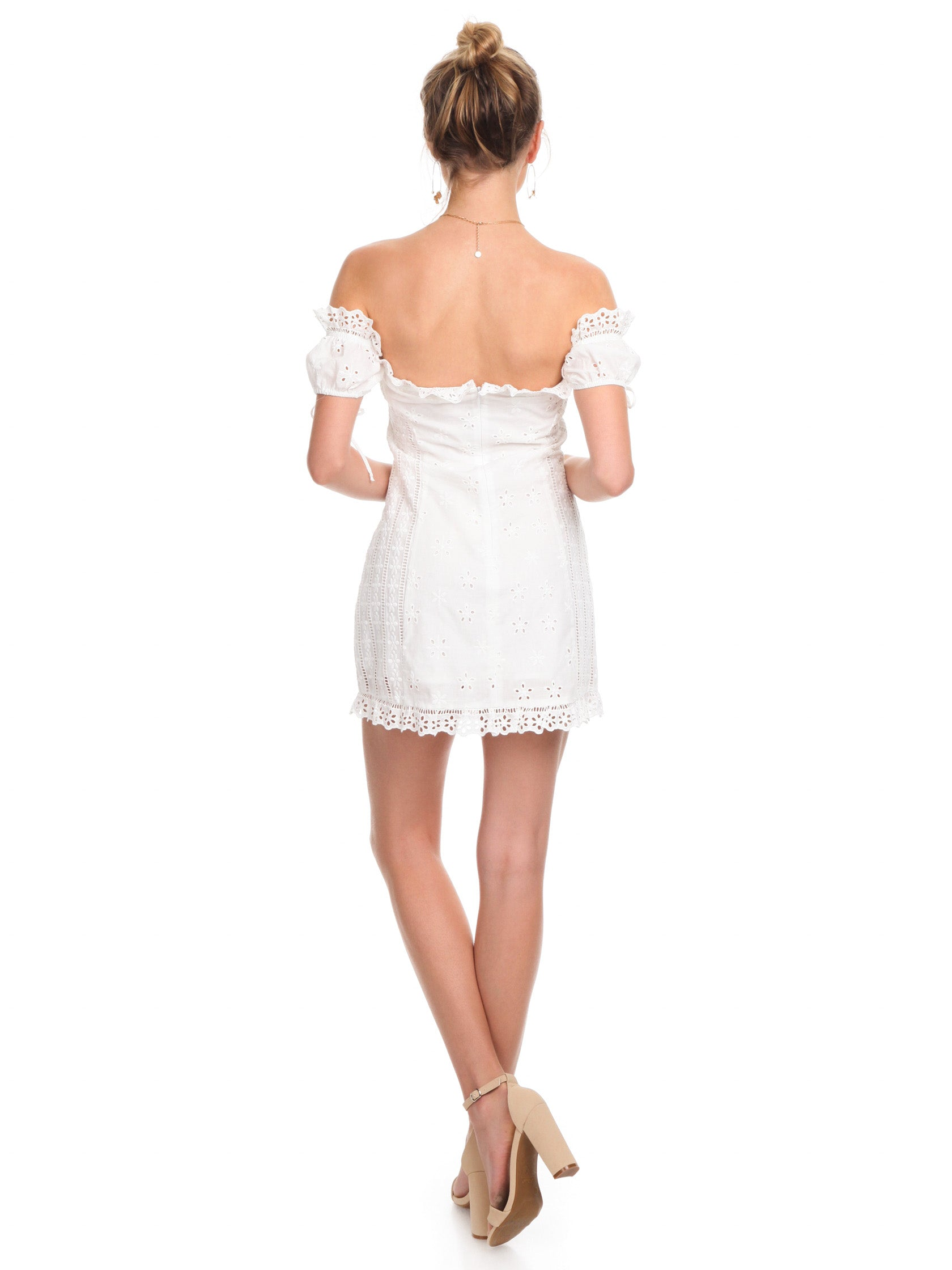 Women wearing a dress rental from For Love & Lemons called Anabelle Eyelet Lace Up Dress