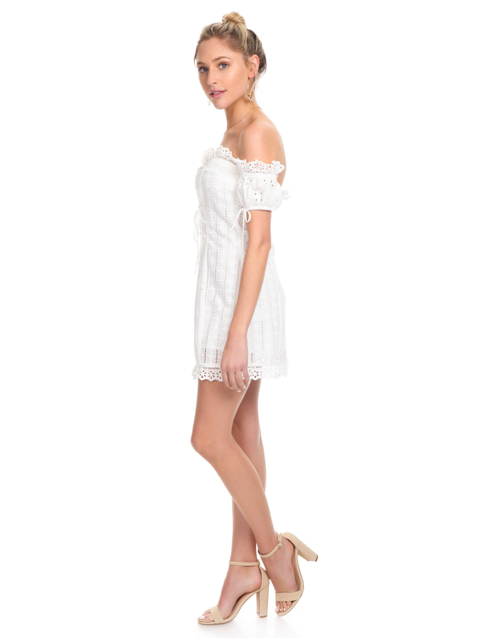 Woman wearing a dress rental from For Love & Lemons called Anabelle Eyelet Lace Up Dress