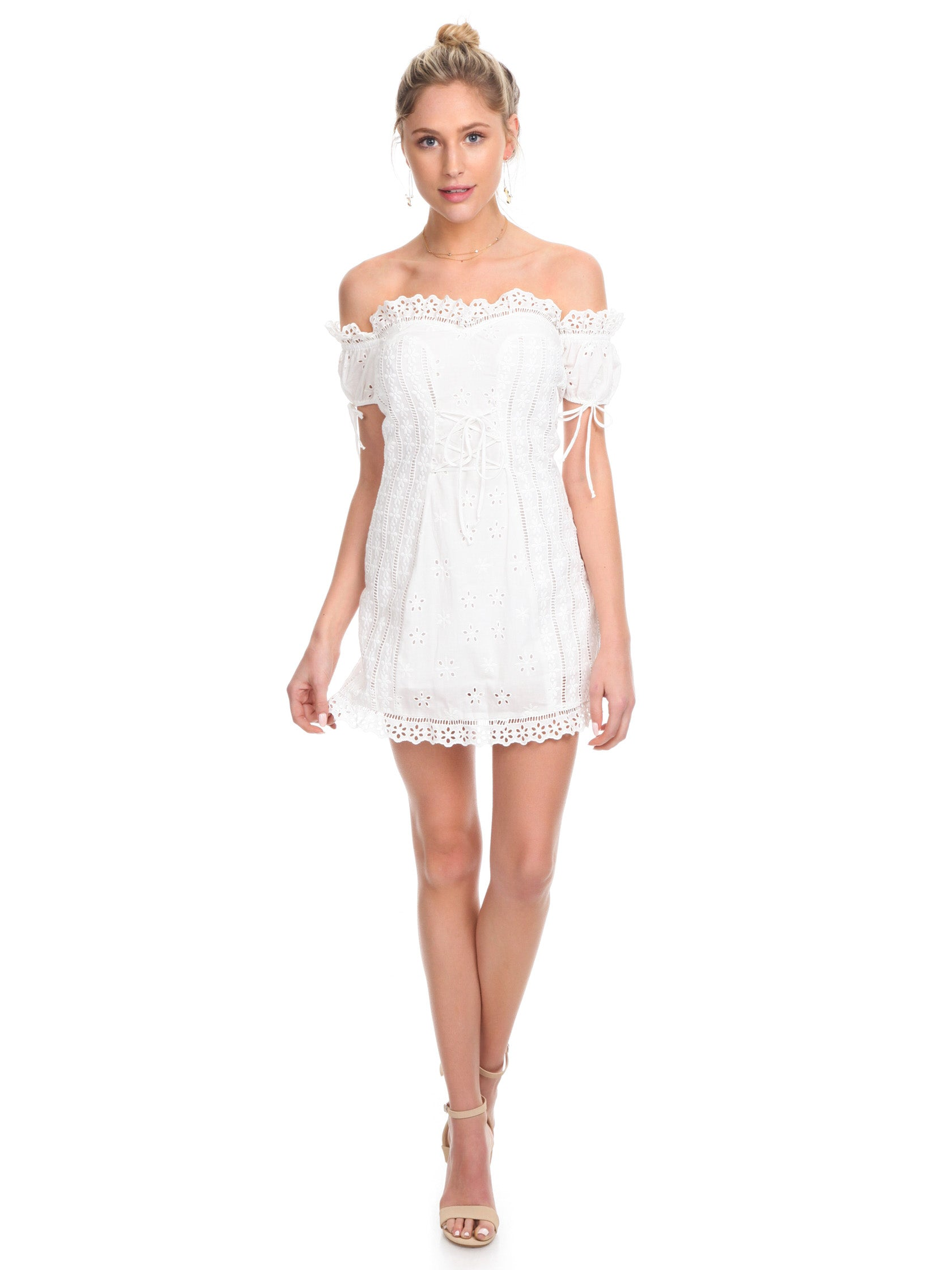 Girl outfit in a dress rental from For Love & Lemons called Anabelle Eyelet Lace Up Dress
