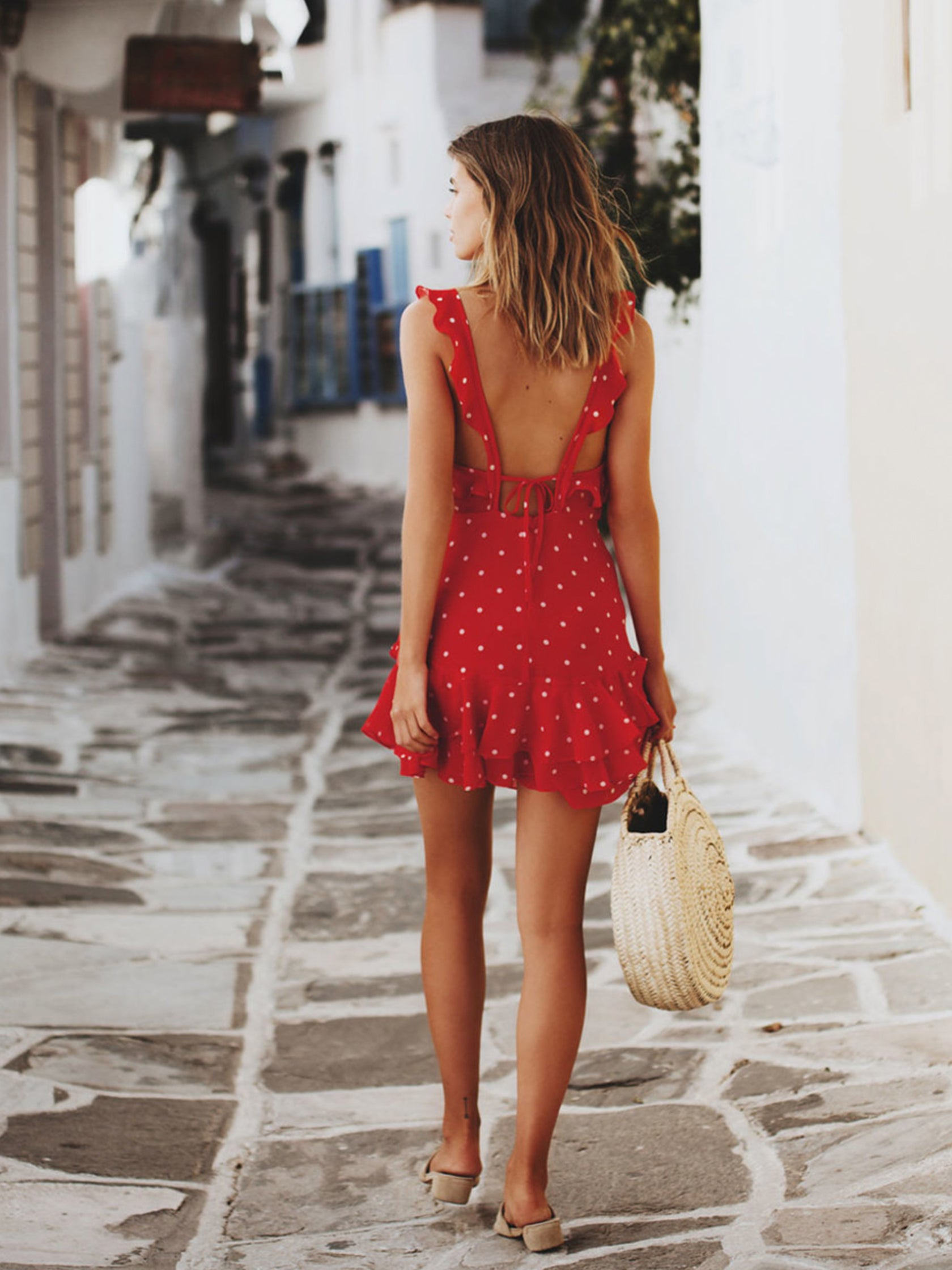 Girl outfit in a dress rental from For Love & Lemons called Analisa Polka Dot Tank Dress