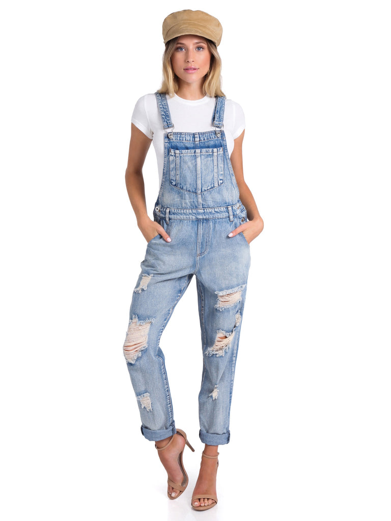 Women wearing a jumpsuit rental from FashionPass called Presley High Rise Girlfriend Jeans