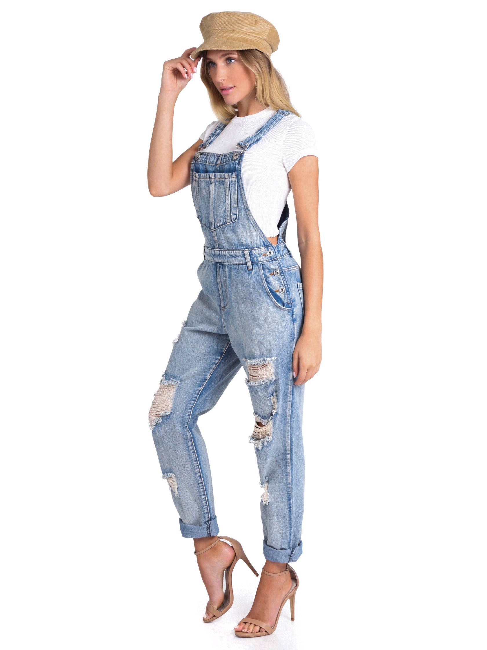 Woman wearing a jumpsuit rental from FashionPass called Andie Overalls