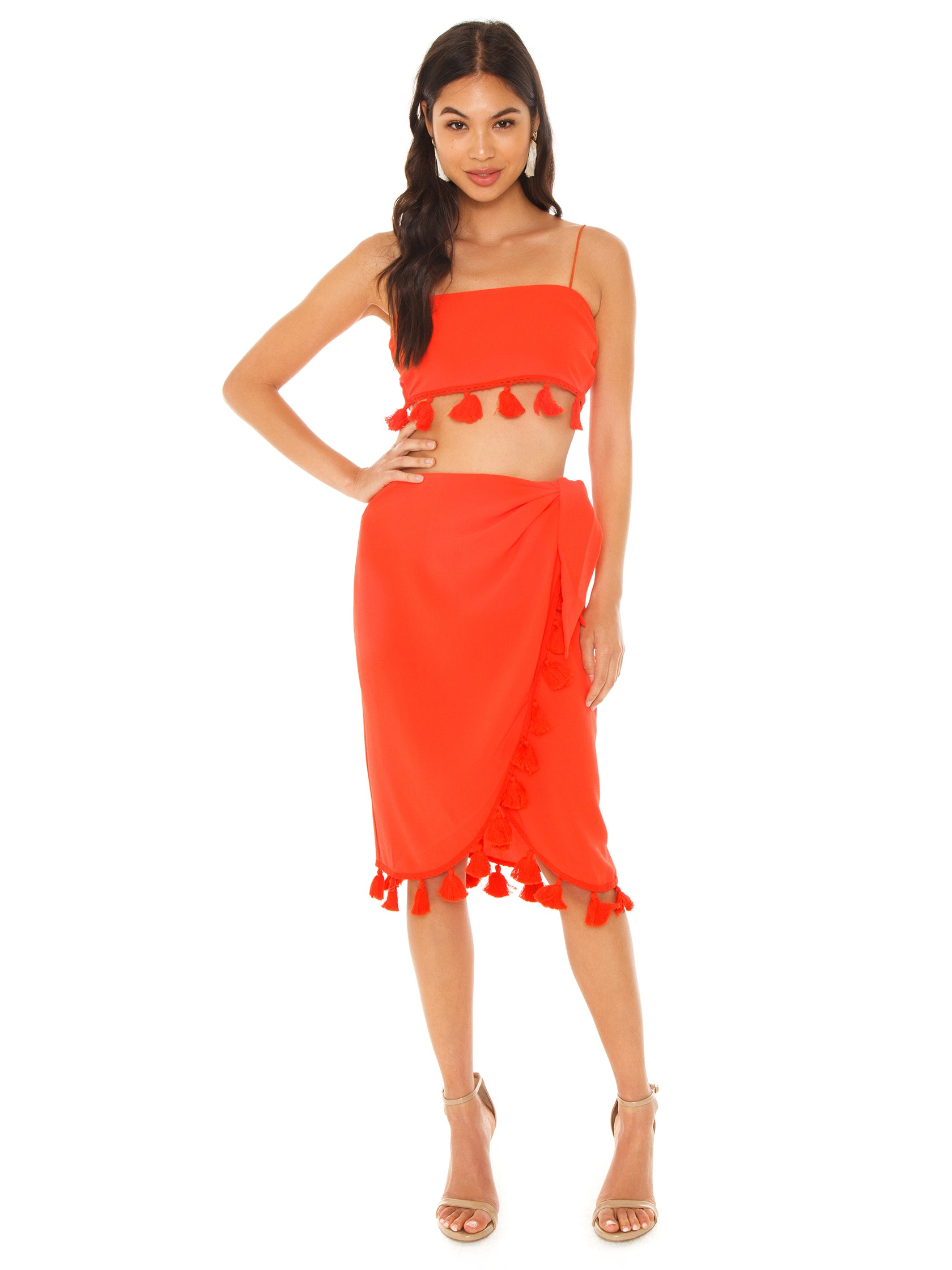 Woman wearing a skirt rental from Show Me Your Mumu called Anjolie Wrap Skirt W/tassels
