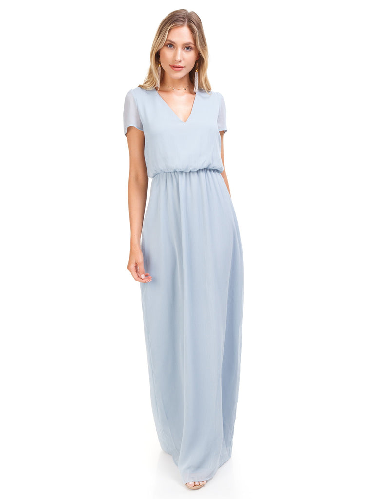 Woman wearing a dress rental from WAYF called Meryl Long Sleeve Wrap Maxi Dress