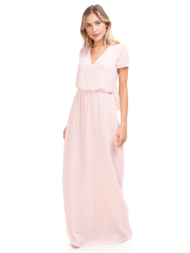 Women wearing a dress rental from WAYF called Gwyneth Ruffle Maxi Dress