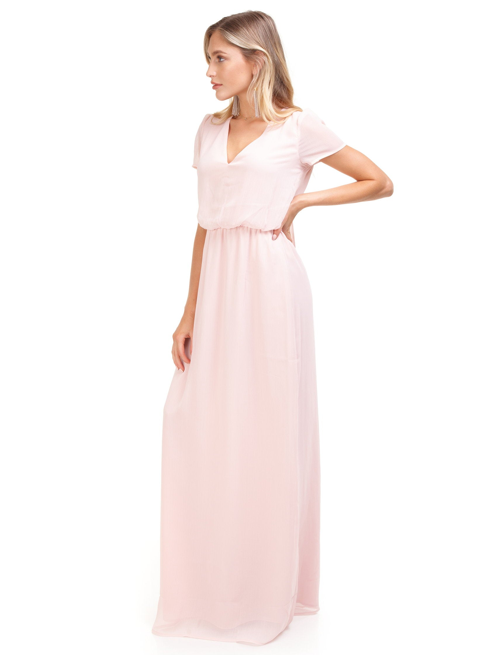 Woman wearing a dress rental from WAYF called Anna V-neck Tie Back Maxi