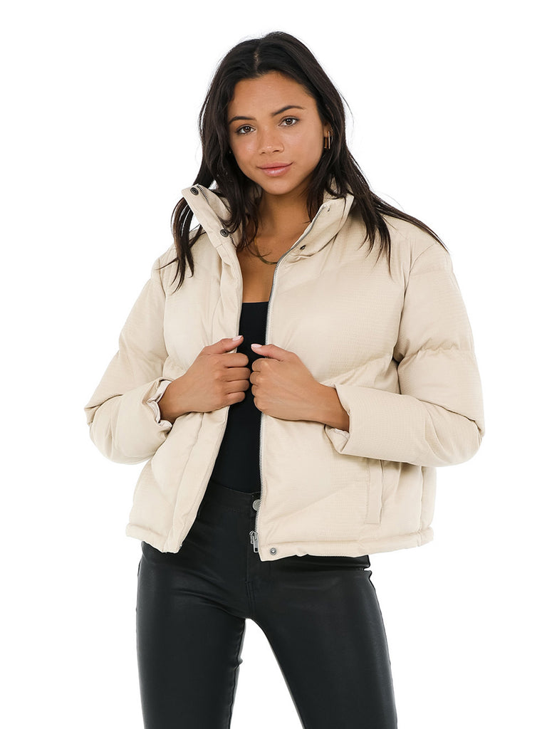 Women wearing a jacket rental from BB DAKOTA called Answer My Layer Puffer