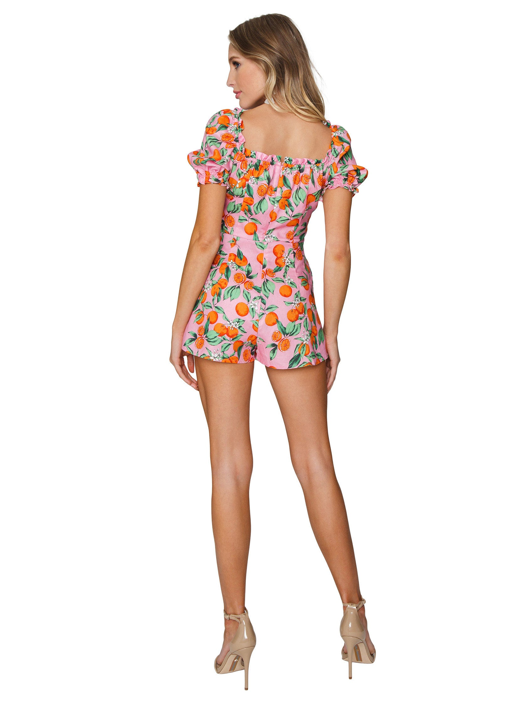 Women wearing a romper rental from Finders Keepers called Aranciata Playsuit