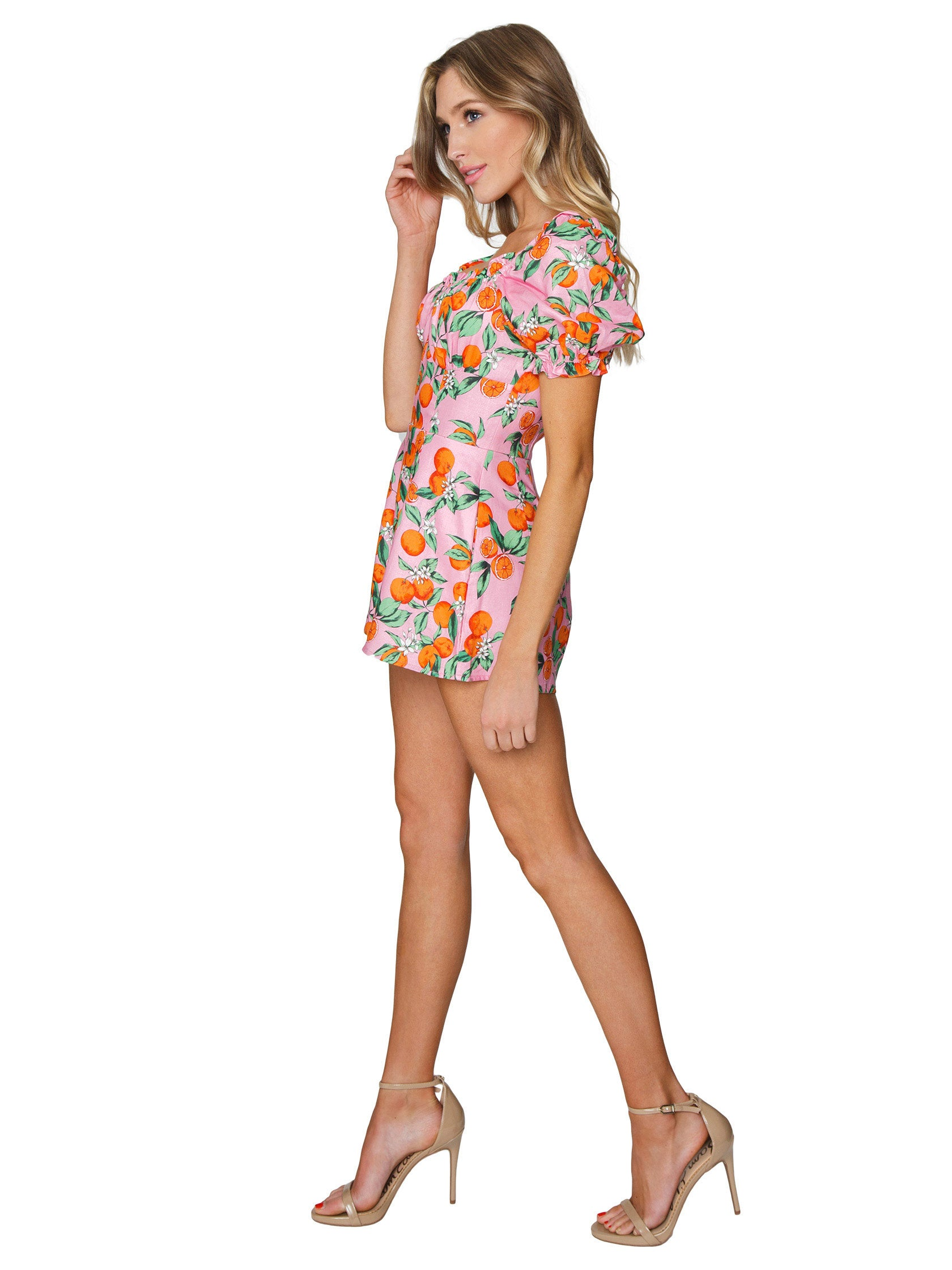 Woman wearing a romper rental from Finders Keepers called Aranciata Playsuit