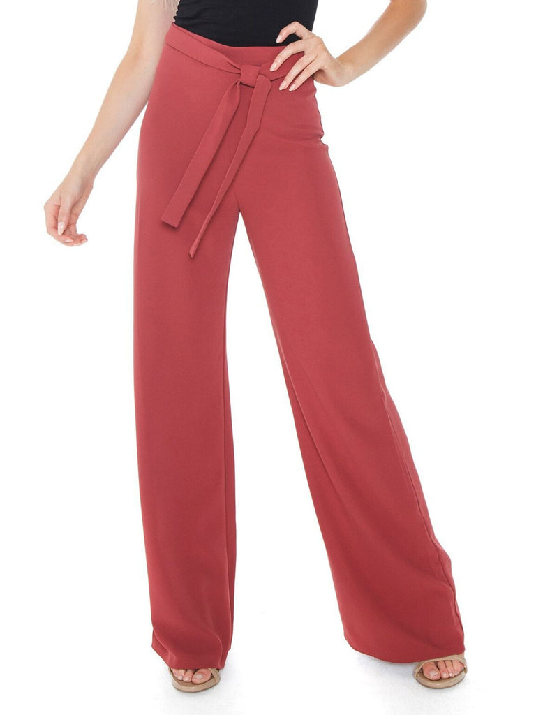 Woman wearing a pants rental from Amanda Uprichard called Tie Front Blouse