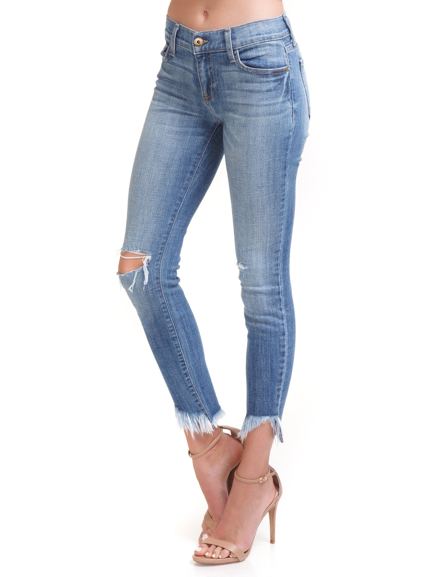 Women wearing a denim rental from PISTOLA called Audrey Distressed Crop Jeans