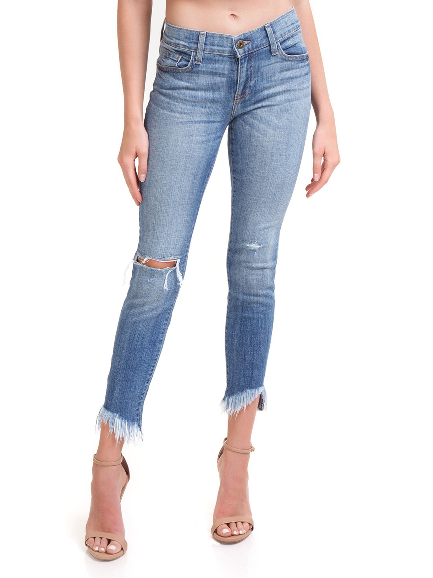 Woman wearing a denim rental from PISTOLA called Audrey Distressed Crop Jeans
