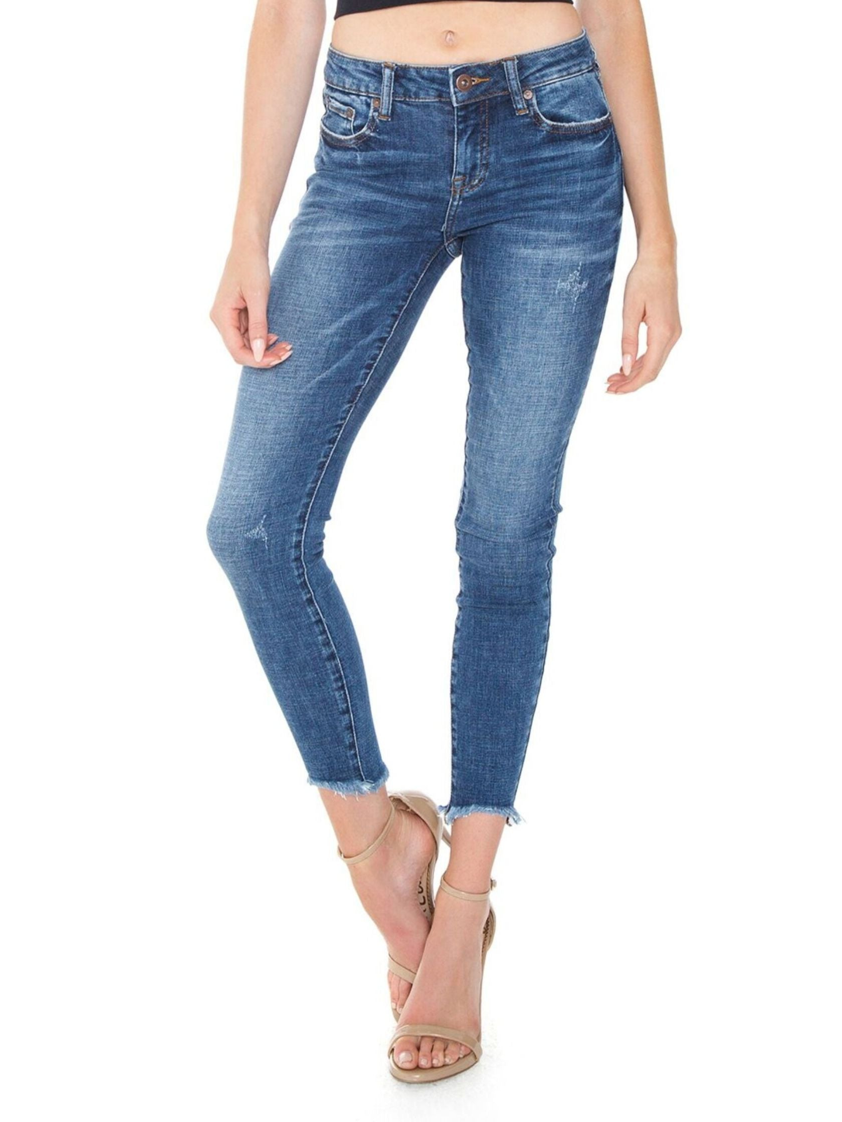 Woman wearing a denim rental from PISTOLA called Audrey Mid Rise Skinny
