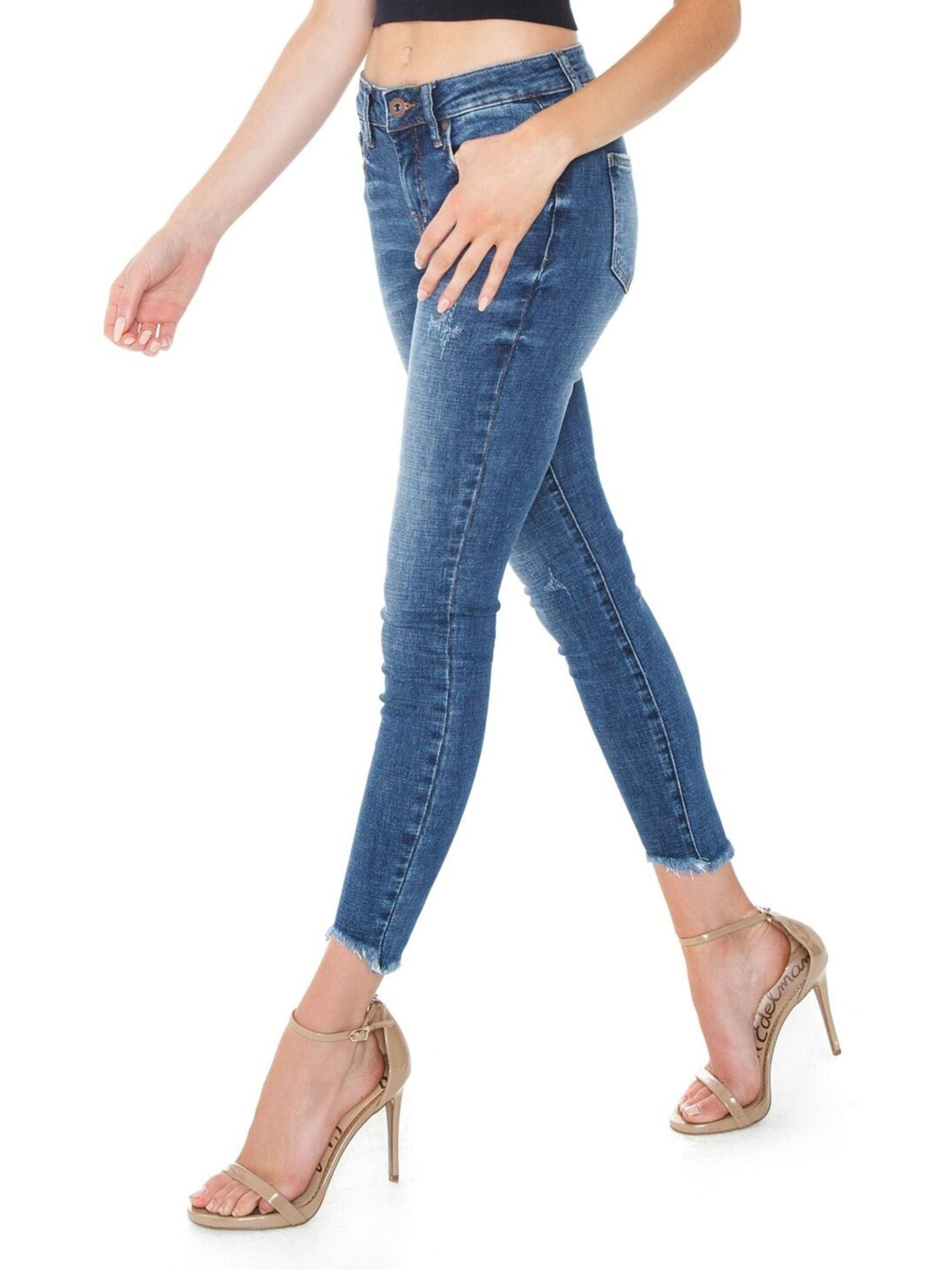 Women wearing a denim rental from PISTOLA called Audrey Mid Rise Skinny