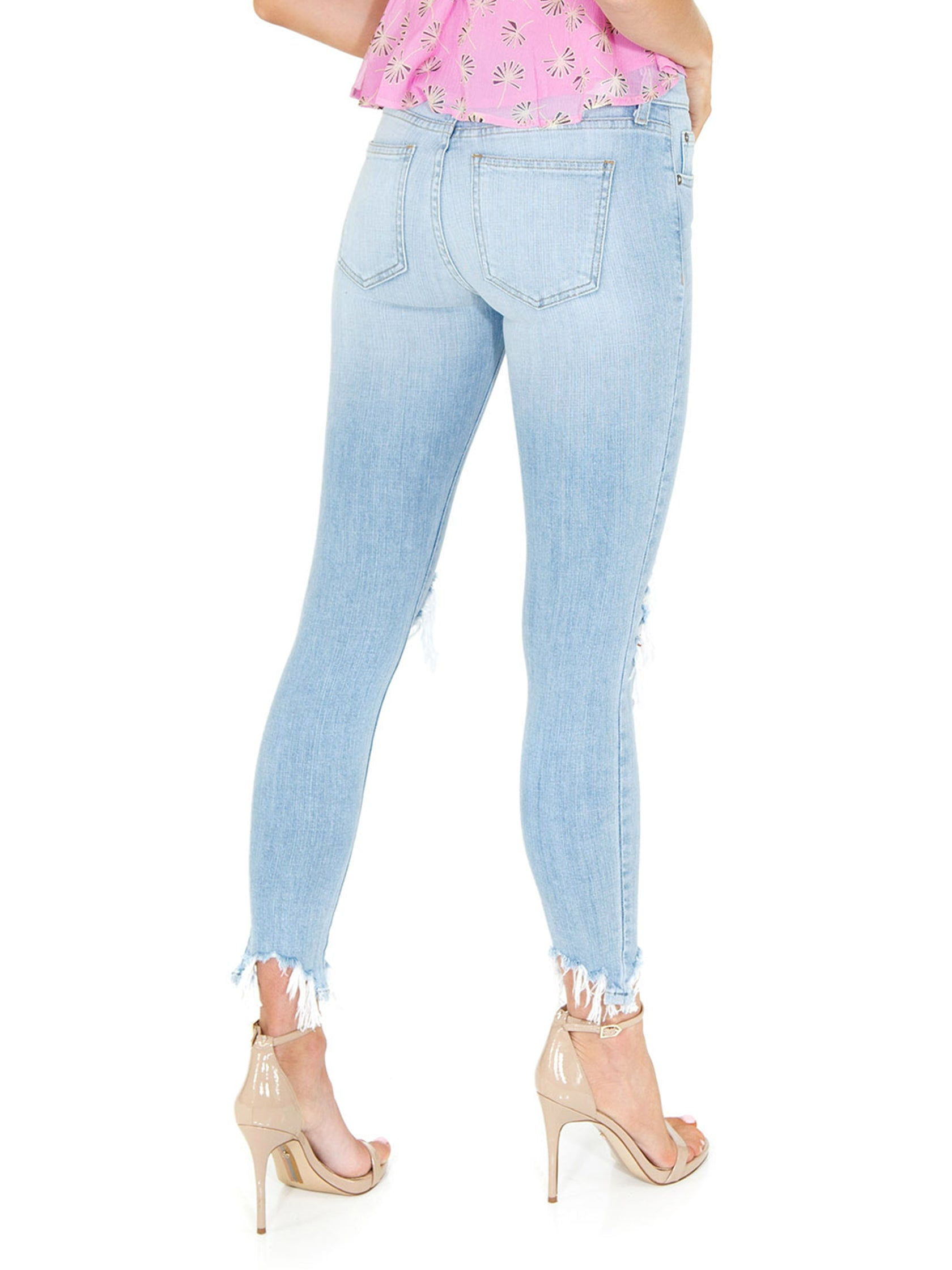 Women outfit in a denim rental from PISTOLA called Audrey Mid Rise Skinny Jeans
