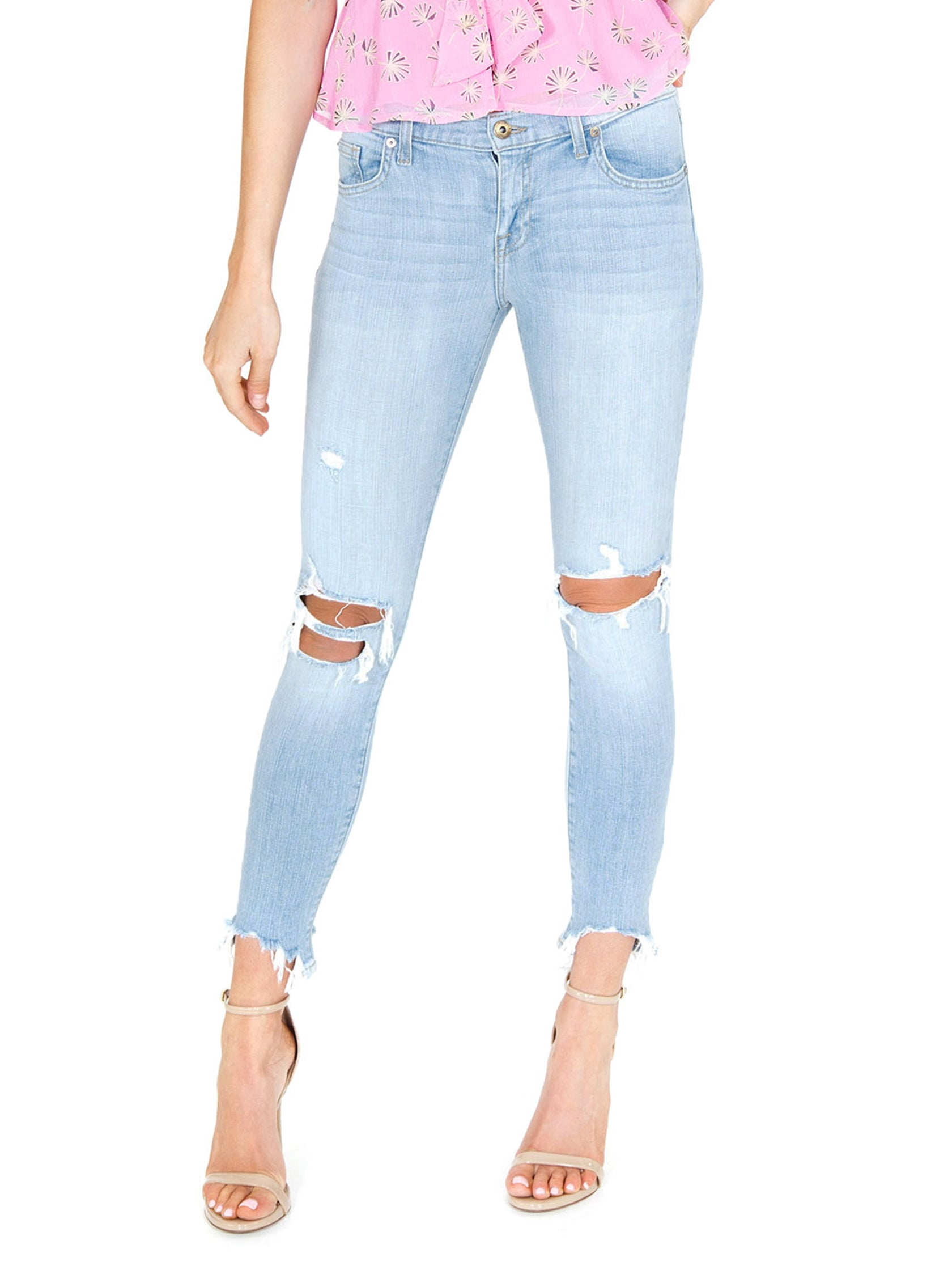 Woman wearing a denim rental from PISTOLA called Audrey Mid Rise Skinny Jeans