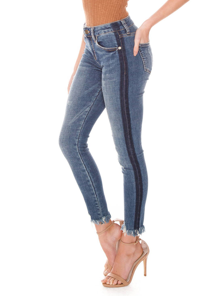 Girl wearing a denim rental from PISTOLA called Audrey Mid Rise Skinny Jeans
