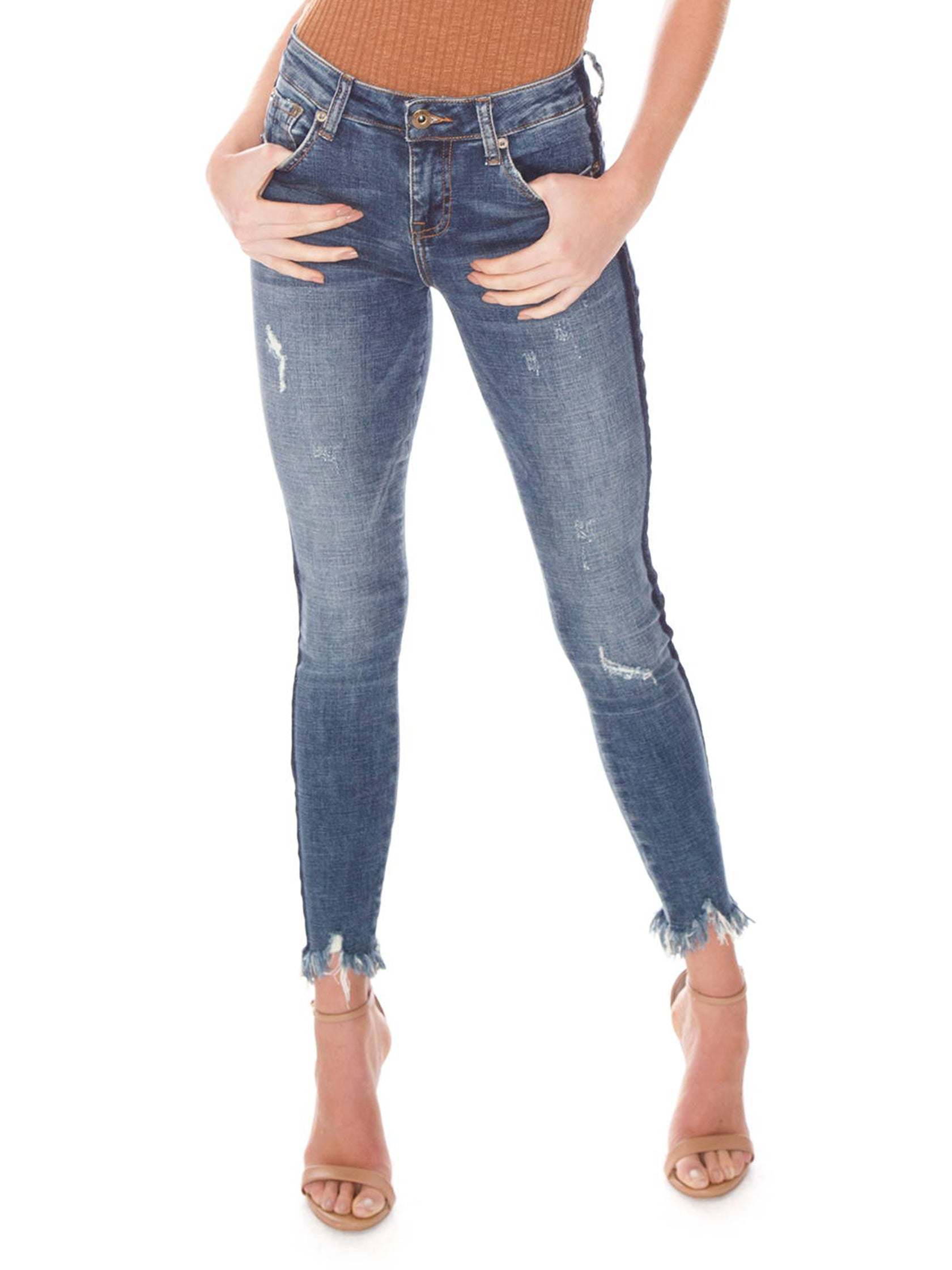 Women wearing a denim rental from PISTOLA called Audrey Mid Rise Skinny Jeans - Situational