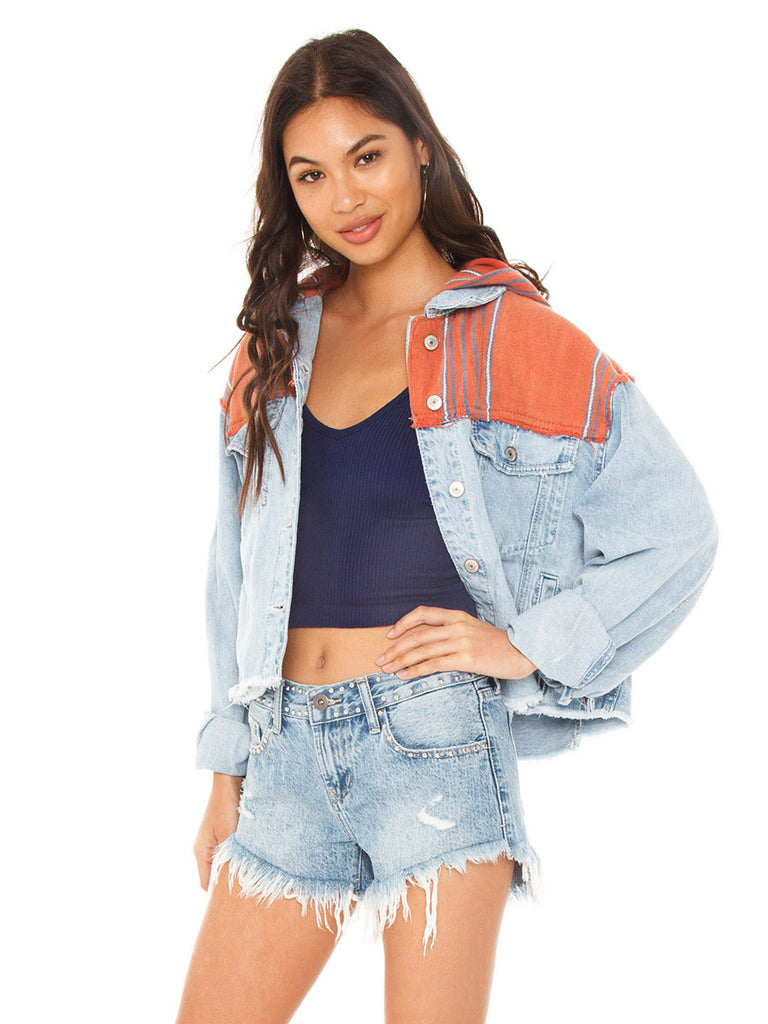 Woman wearing a jacket rental from Free People called Rumors Denim Jacket