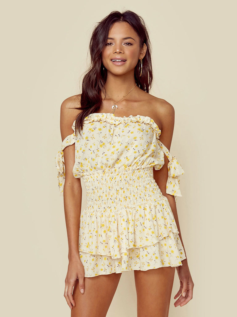 Girl wearing a romper rental from Blue Life called Dance Till Dawn Romper