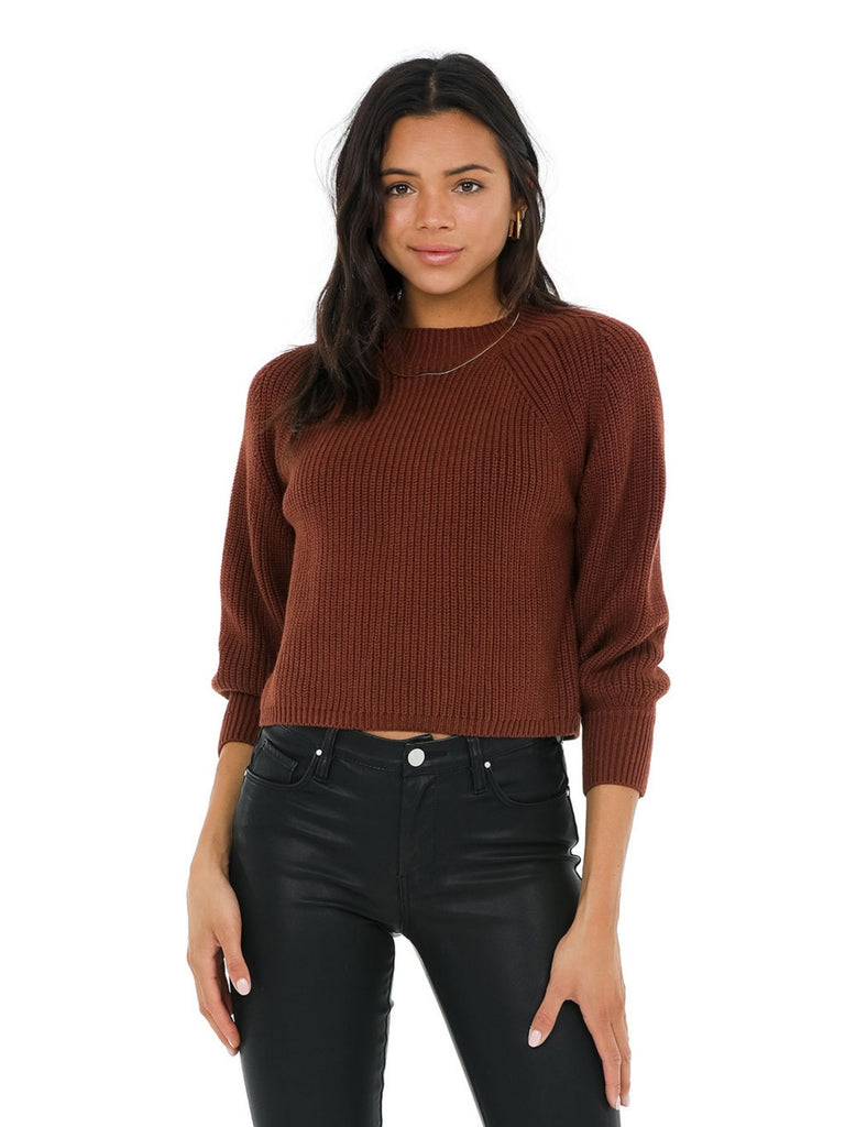 Woman wearing a sweater rental from 525 called Ribbed Bike Short
