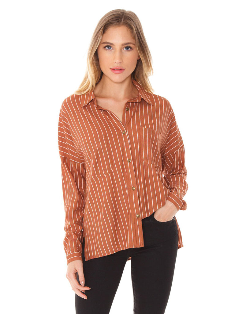Woman wearing a top rental from SAGE THE LABEL called Ruffle Sleeve Striped Sweater