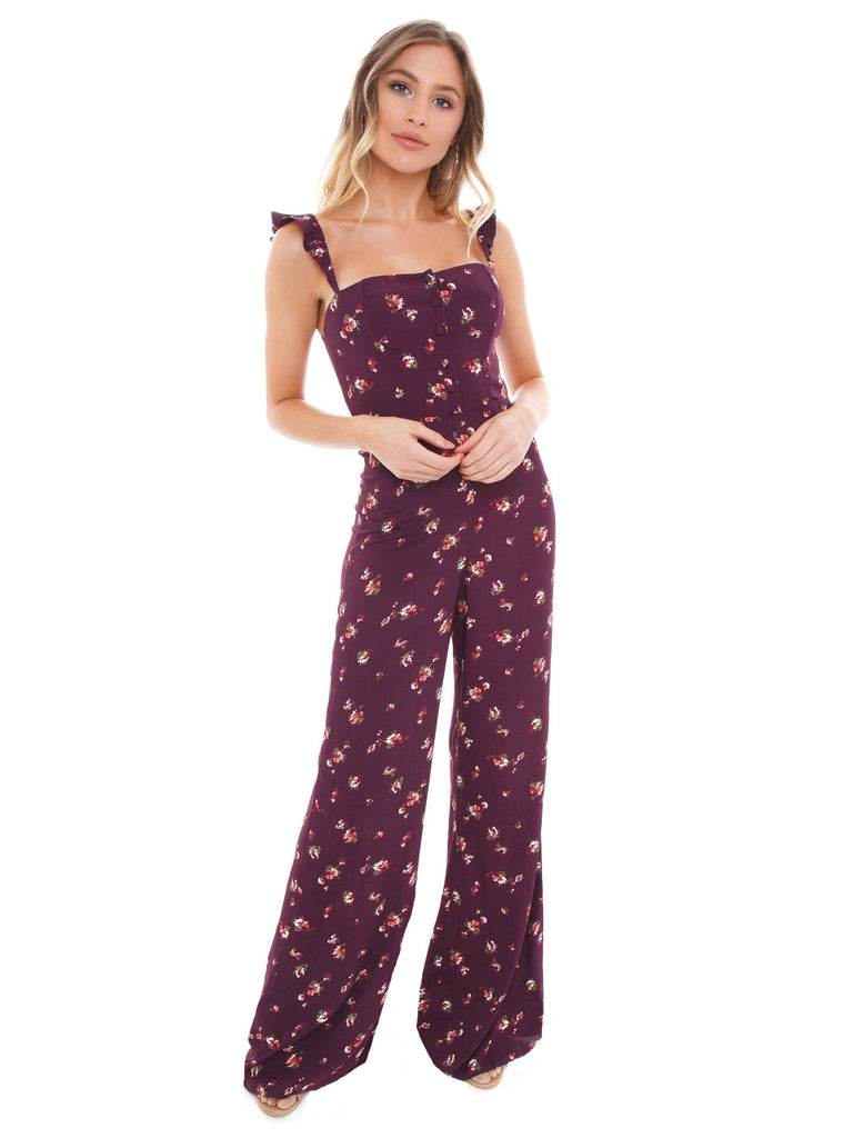 Girl wearing a jumpsuit rental from Flynn Skye called Flutter Sleeve Wide Leg Jumpsuit