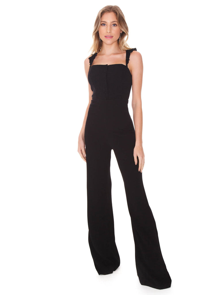 Women wearing a jumpsuit rental from Flynn Skye called Velvet Flutter Sleeve Wrap Dress