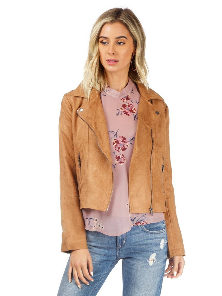Woman wearing a jacket rental from BB Dakota called V-neck Ruffle Sleeve Top