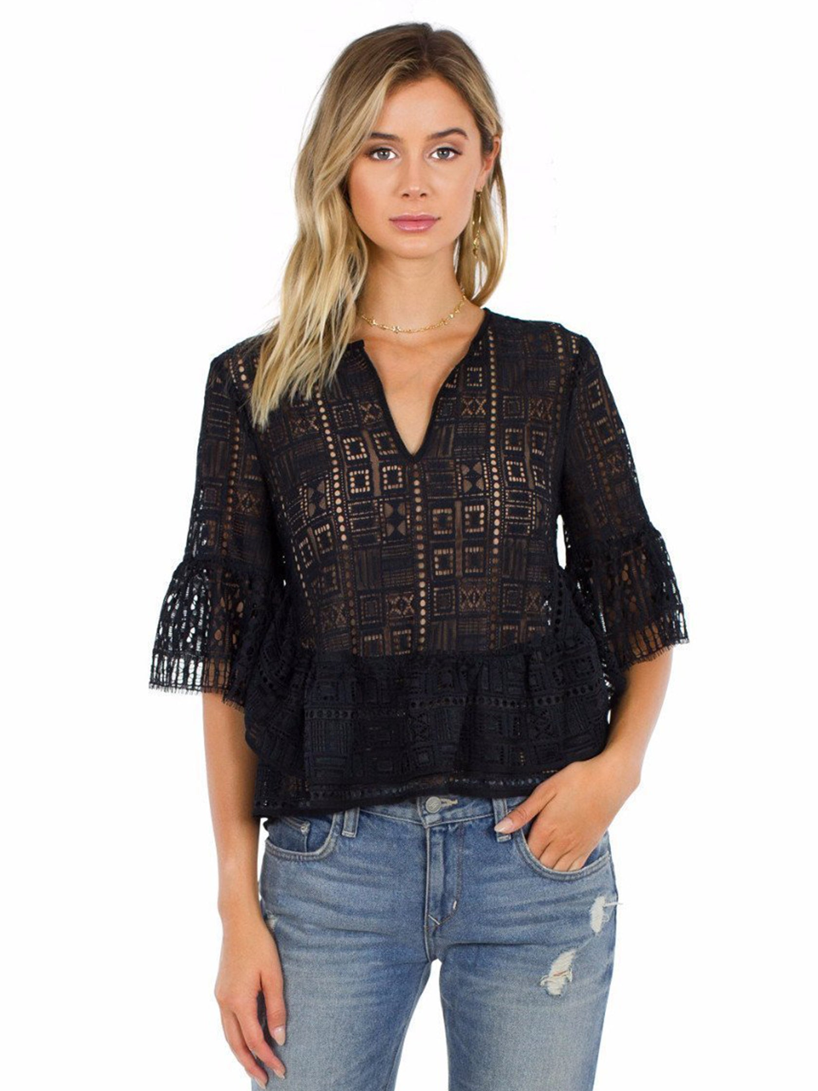 Woman wearing a top rental from BCBGMAXAZRIA called Immane Ruffled Lace Top