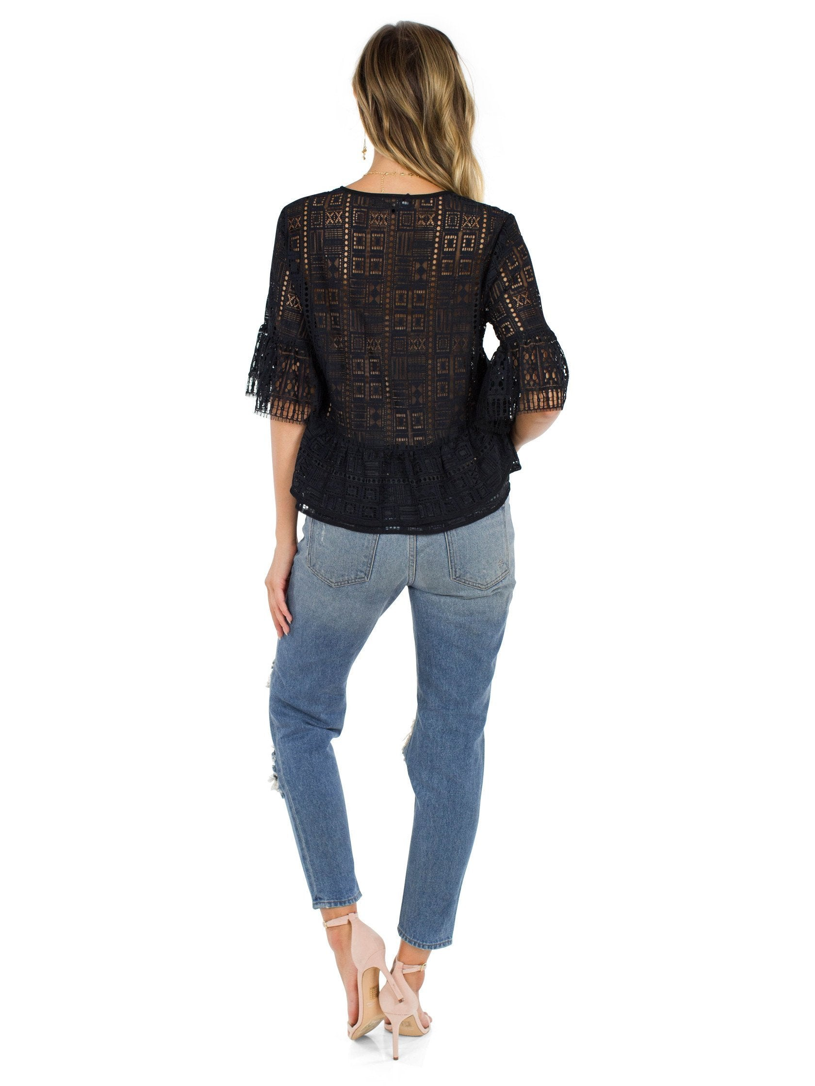 Women outfit in a top rental from BCBGMAXAZRIA called Immane Ruffled Lace Top