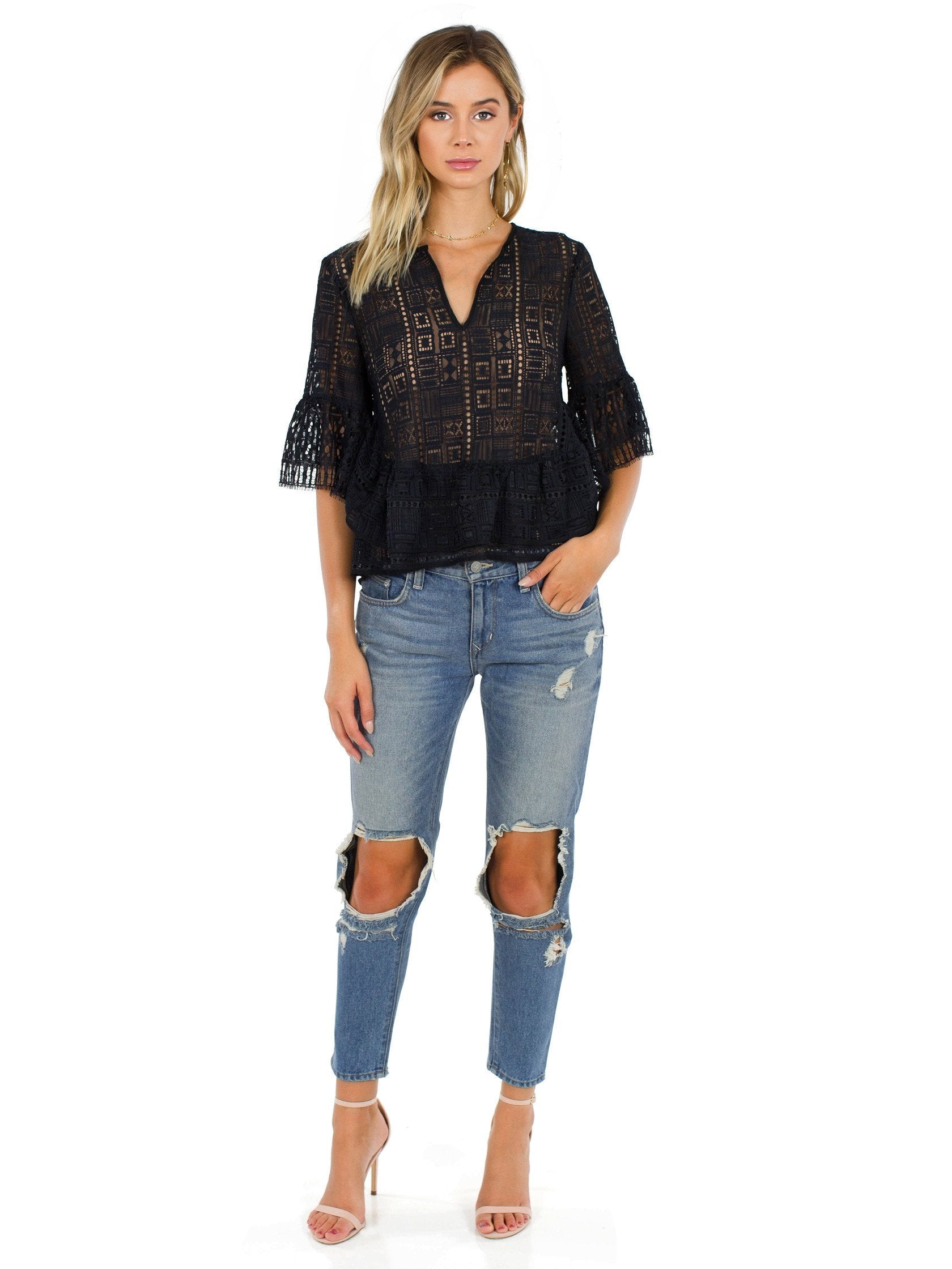 Girl wearing a top rental from BCBGMAXAZRIA called Immane Ruffled Lace Top