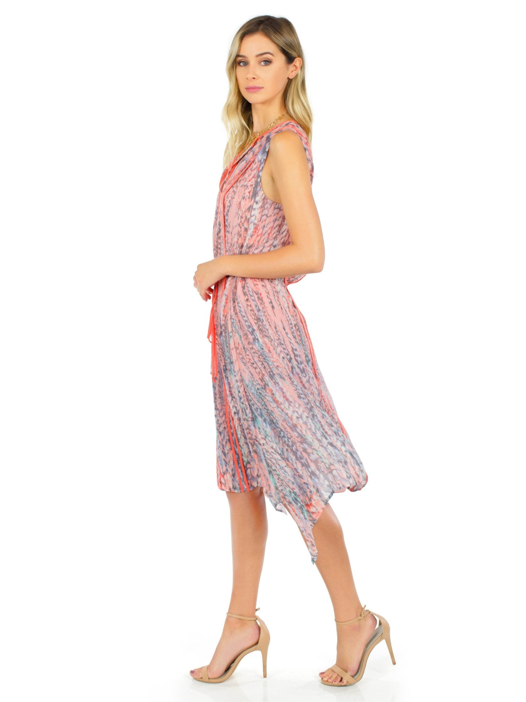 Woman wearing a dress rental from BCBGMAXAZRIA called Liya Print-blocked Draped Dress